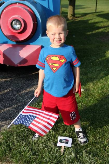 A boy poses with his flag as he continues the scavenger hunt.Schaumburg Park District