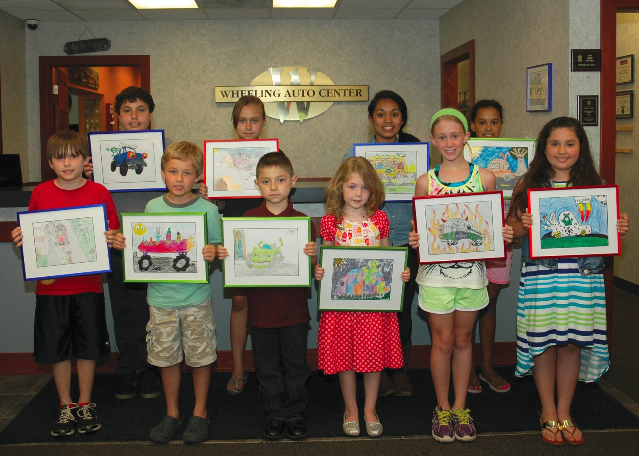 Wheeling Auto Center Art Contest winners, from left, are: Front row: Toby Wachter, Sebastian Palikot, Angel Marquez, Annelise Dreyer, Angelina Craig and Tania Huerta; back row: Jacob Zamora, Nicole Elizabeth Furman, Mariana Montoya and Paige Butler.