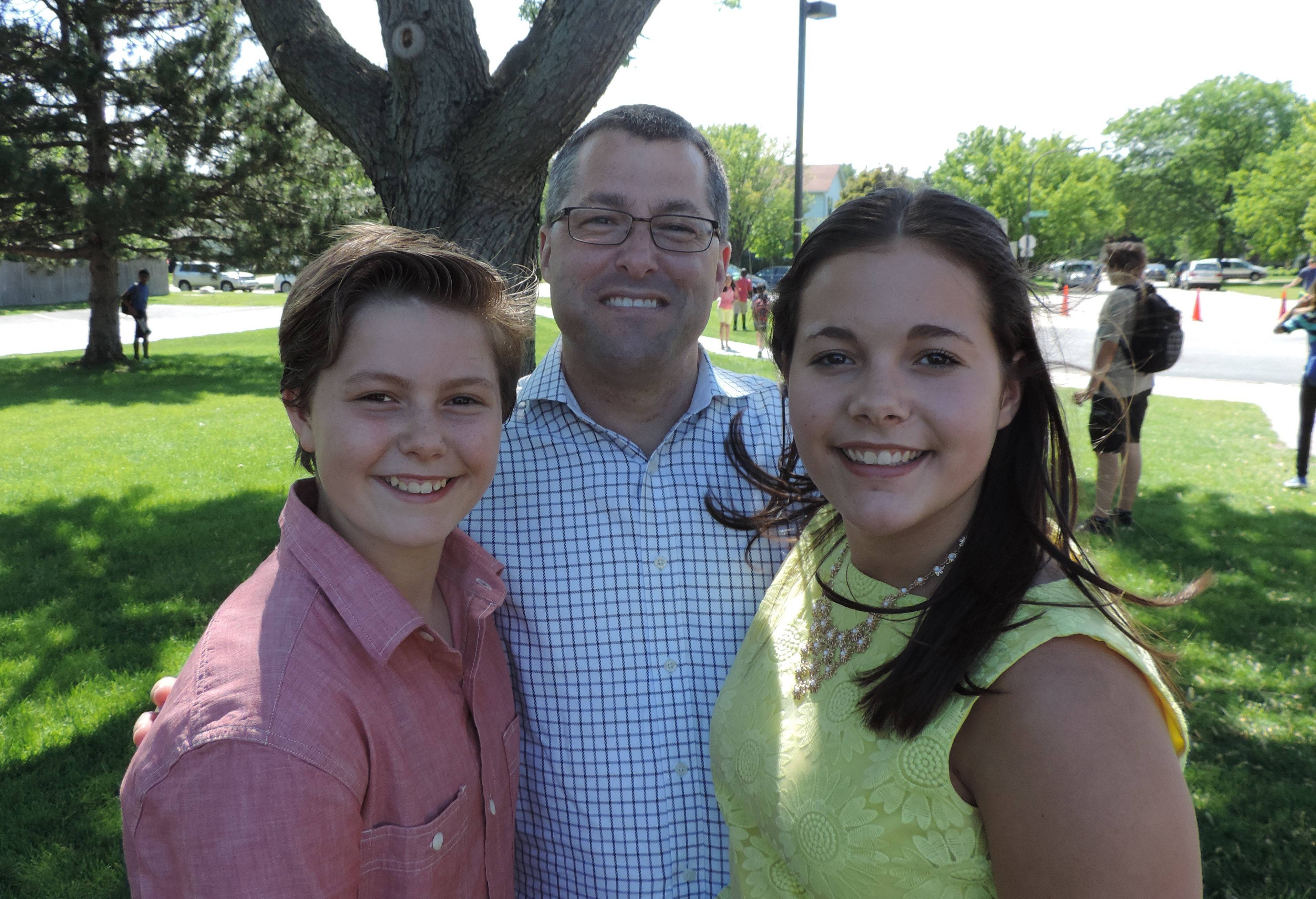 Bill Carrier, with his daughters, Rachel, left, and Lauren, organized Teen Ignite after he had trouble finding cultural and science programming in after school activities for his daughters.