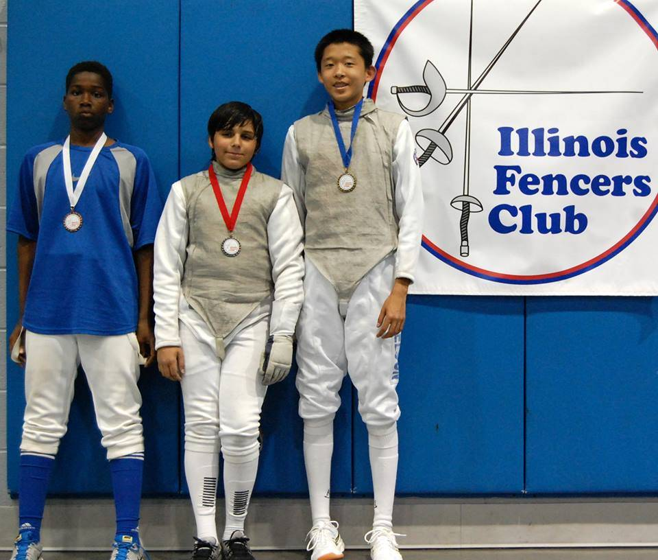 Medal winners in the Y14 mixed epee: (left to right)Ramadah Dinkins, UNAT, bronze; Andrew Vold, IFC, silver; and A J Mikkelson, IFC, gold.Agnieszka Wiosna
