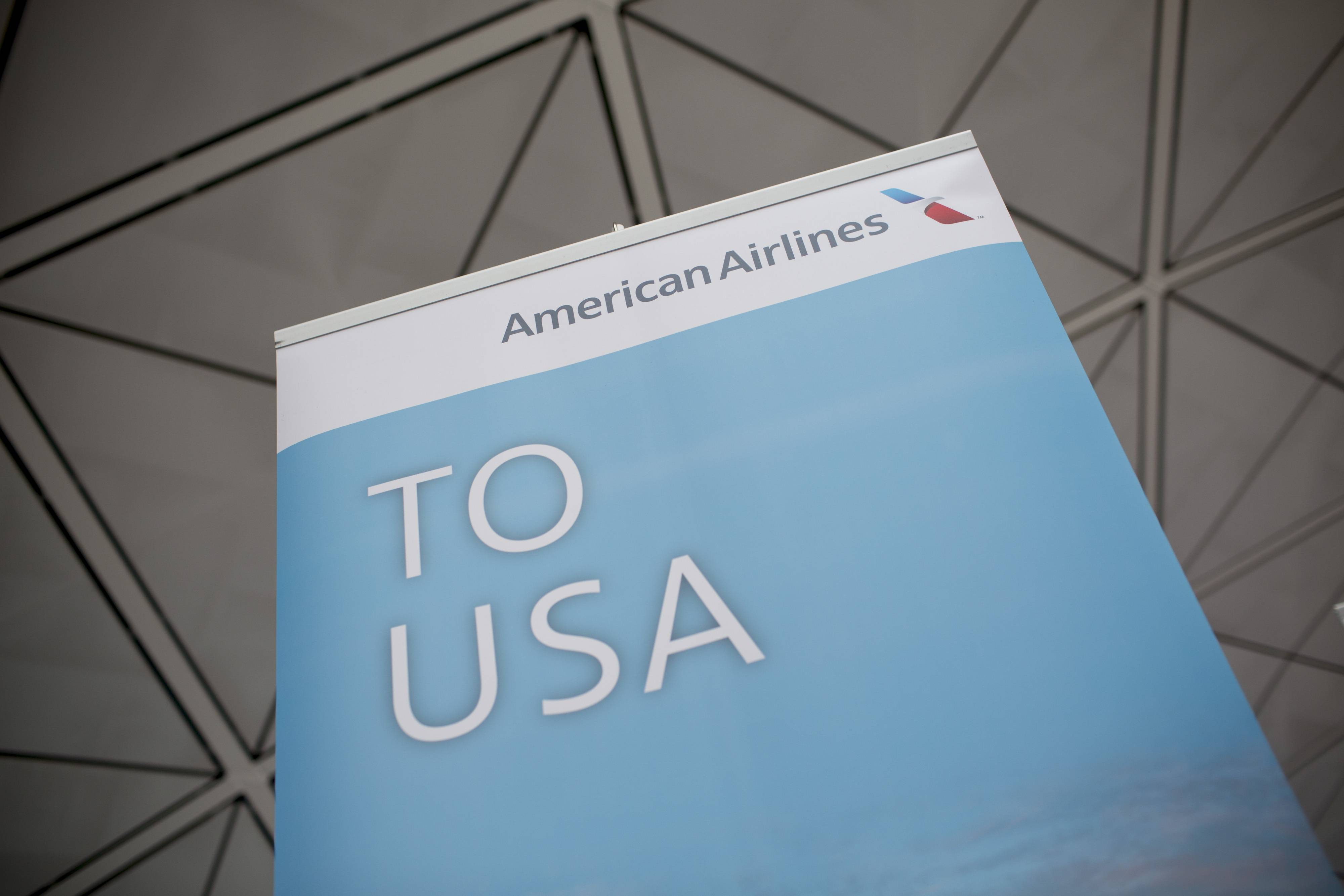 American Airlines Group Inc. signage is displayed Friday during a media event to inaugurate the company's Hong Kong-Dallas route at Hong Kong International Airport in Hong Kong.