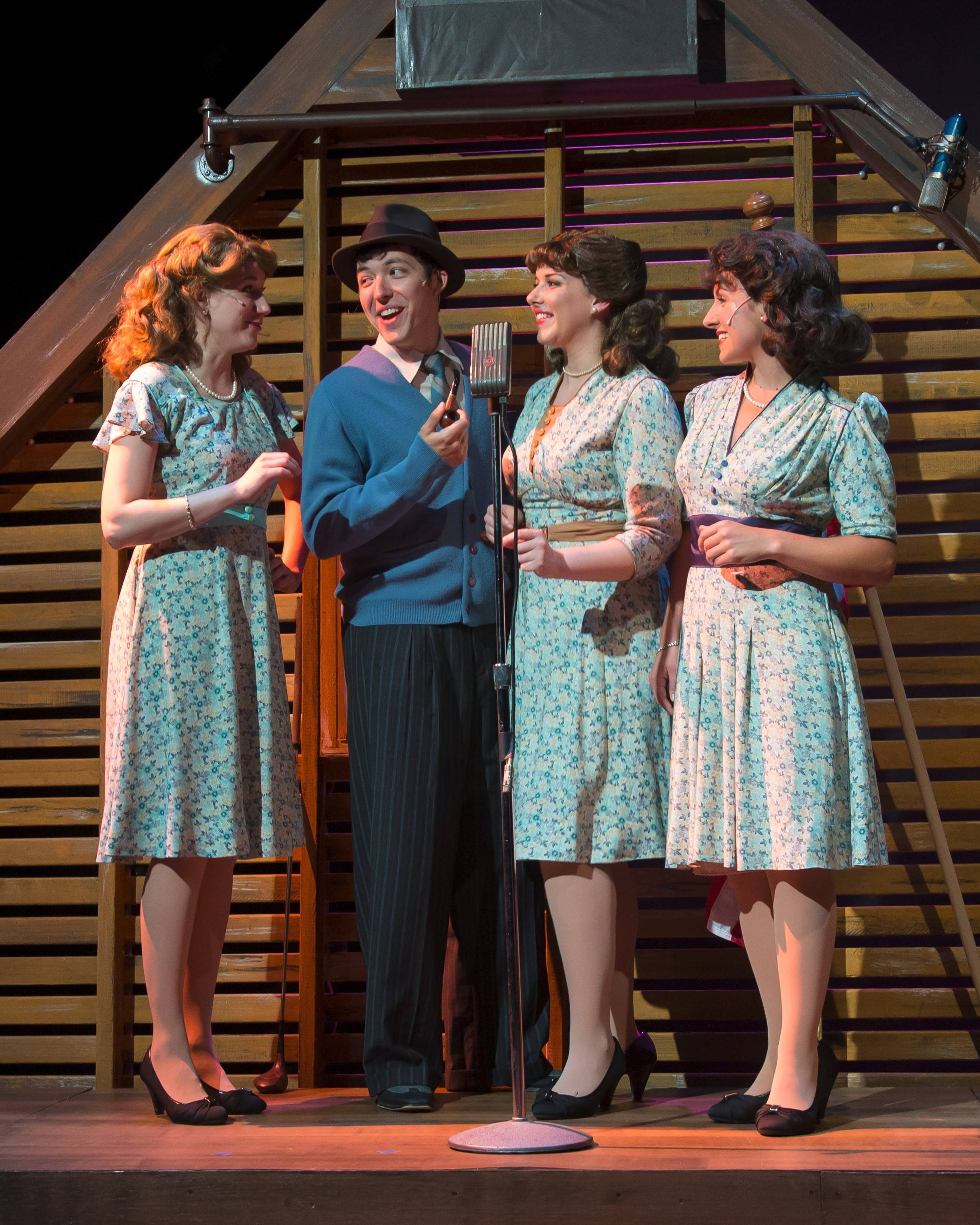 "Patty (Brittany Stock), left, Laverne (Carol Rose) and Maxene Andrews (Kellie Cundiff) record with Bing Crosby (David Hathway) in the Andrews Sisters musical ""Sisters of Swing,"" running through July 27 at Fox Valley Repertory in St. Charles."