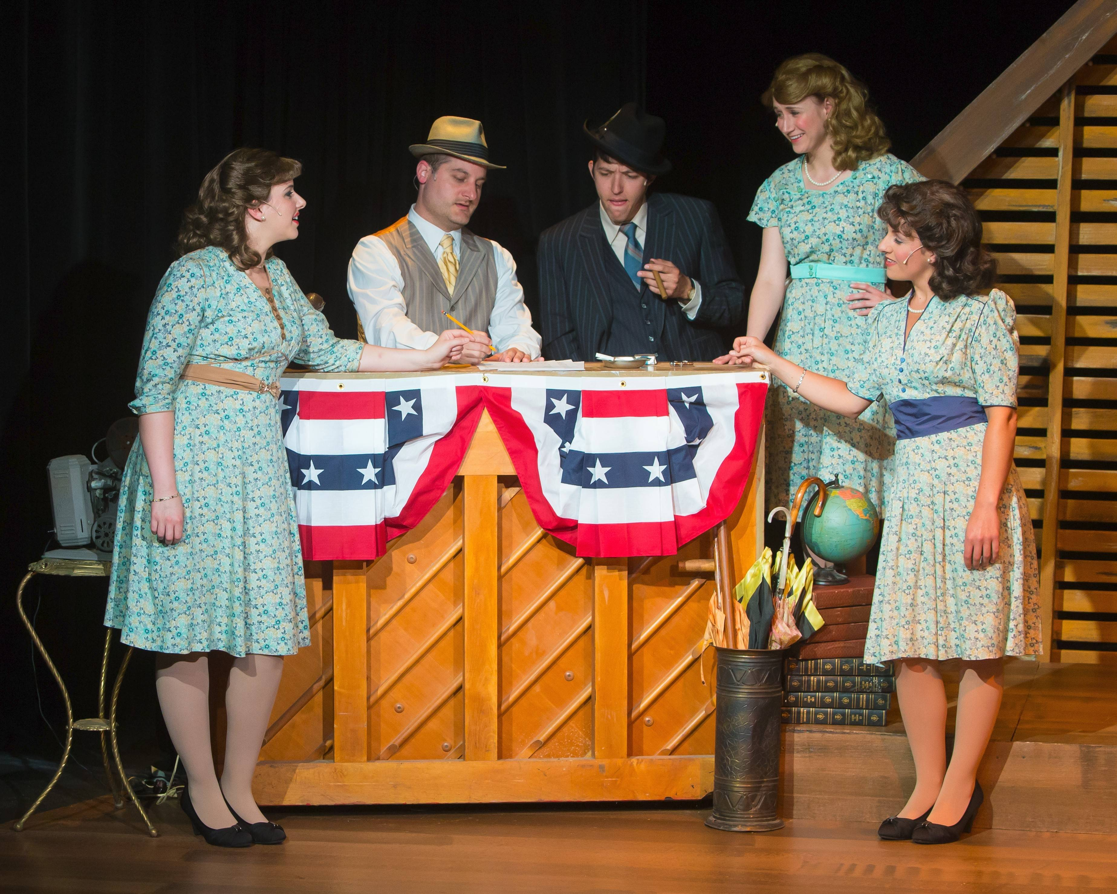 "LaVerne (Carol Rose), left, Patty (Brittany Stock) and Maxene (Kellie Cundiff) confer with their manager Lou (David Hathway), middle, and their arranger, played by music director Jeffrey Poindexter, in Fox Valley Repertory's entertaining revival of ""Sisters of Swing,"" an Andrews Sisters bio-musical."