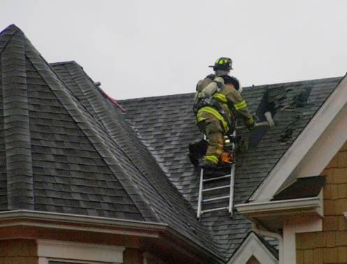 Three firefighters avoided serious injury Wednesday when lightning struck near a home where they were battling a blaze on a fire truck ladder.