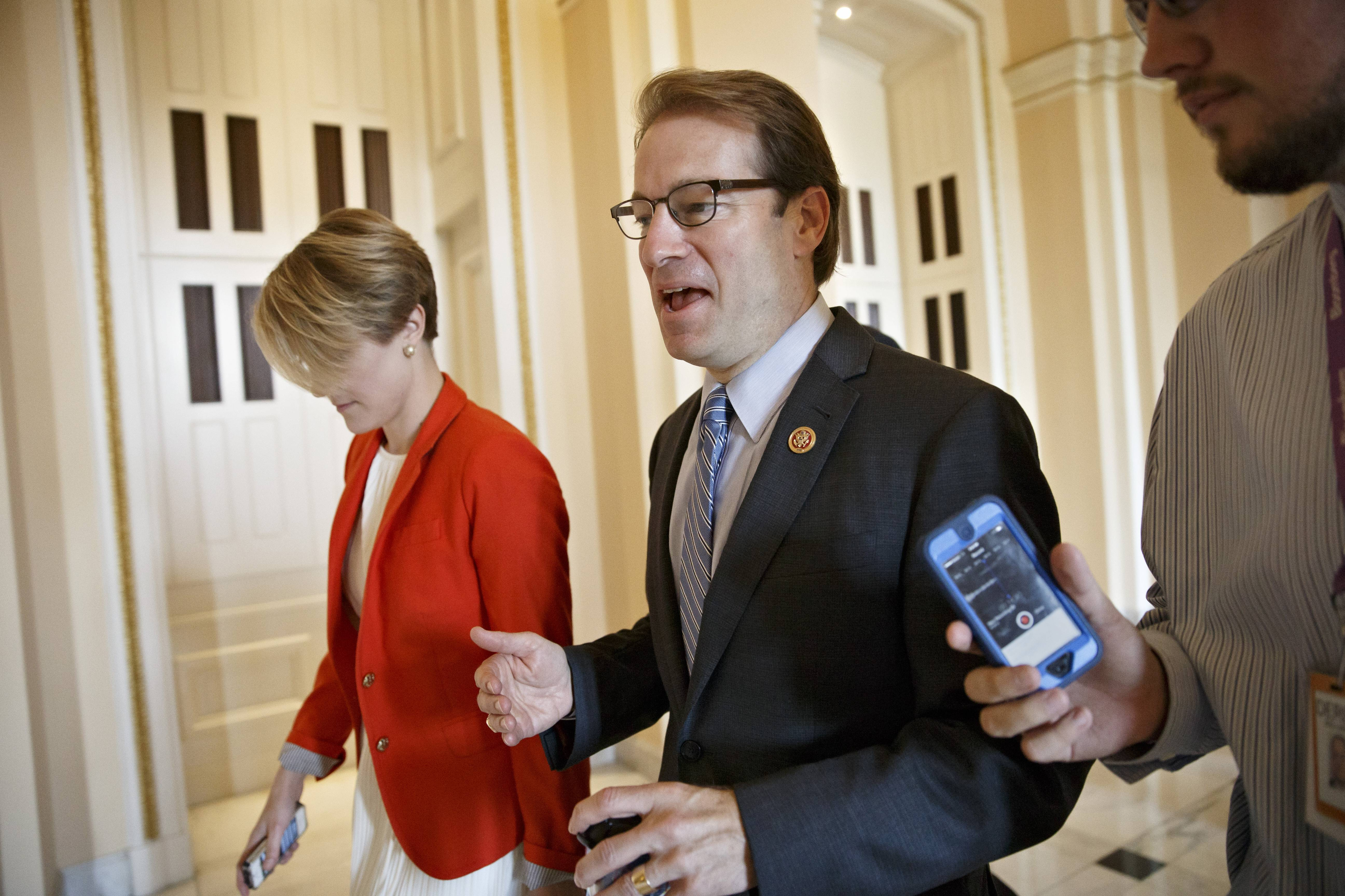U.S. Rep. Peter Roskam of Wheaton speaks with a reporter on Capitol Hill Thursday.
