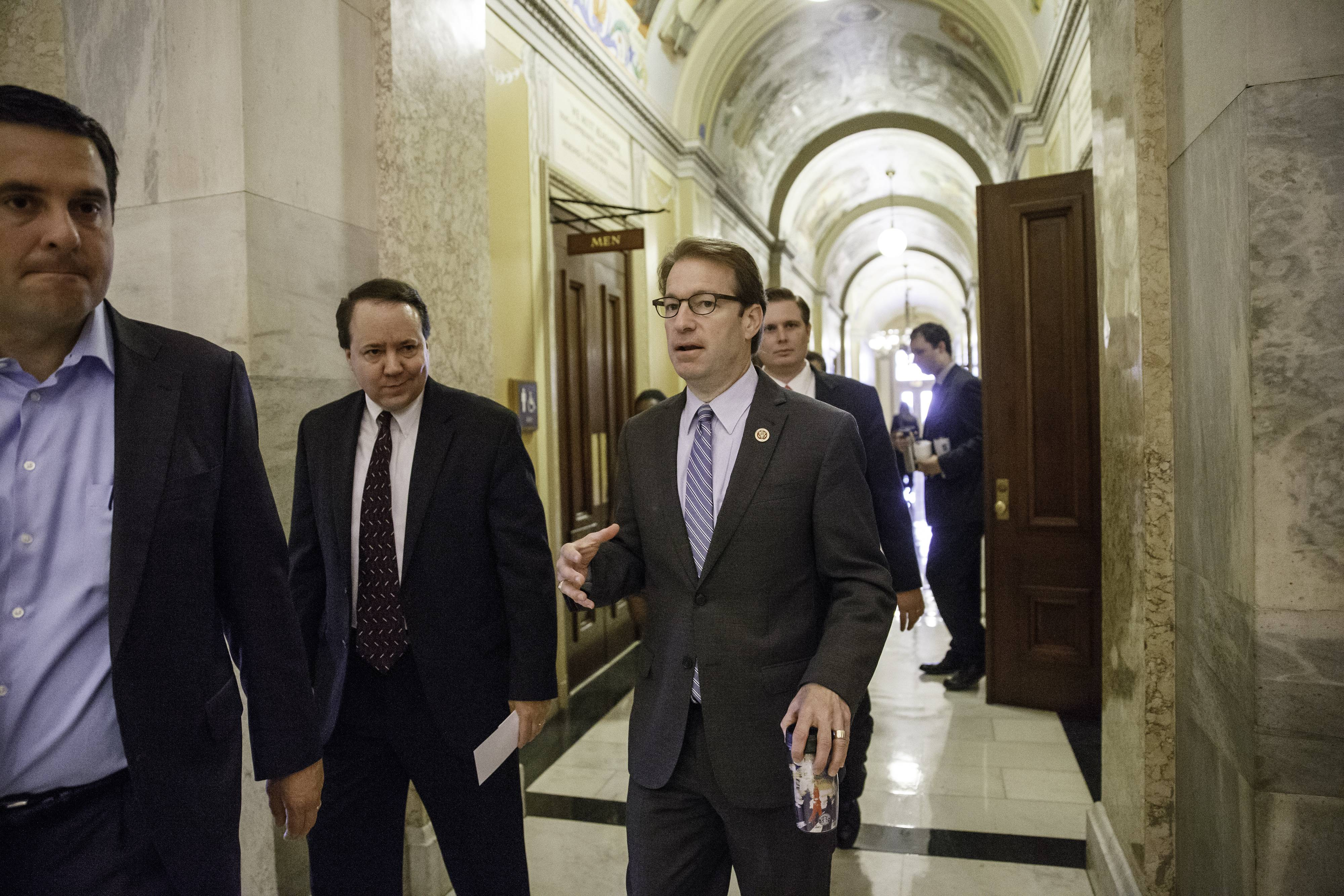U.S. Rep. Peter Roskam of Wheaton speaks with Republican Reps. Devin Nunes of California, left, and Pat Tiberi of Ohio, second from left, before a leadership vote Thursday at the Capitol in Washington, D.C.