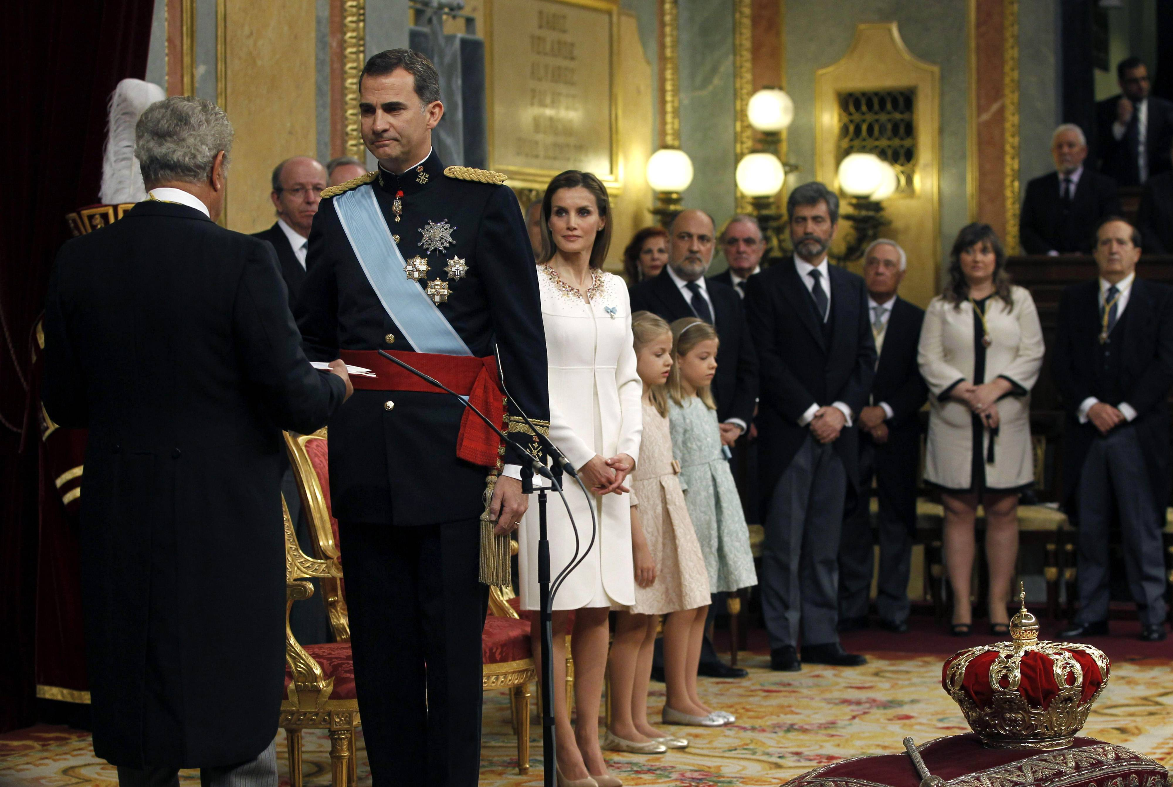 Spain's King Felipe VI, left, is sworn in Thursday as the new Spanish King during ceremony at the Spanish parliament in Madrid. Felipe's father Juan Carlos, who reigned during four decades, stepped down after signing an abdication law Wednesday so that younger royal blood can rally a country beset by economic problems, including an unemployment rate of 25 percent.