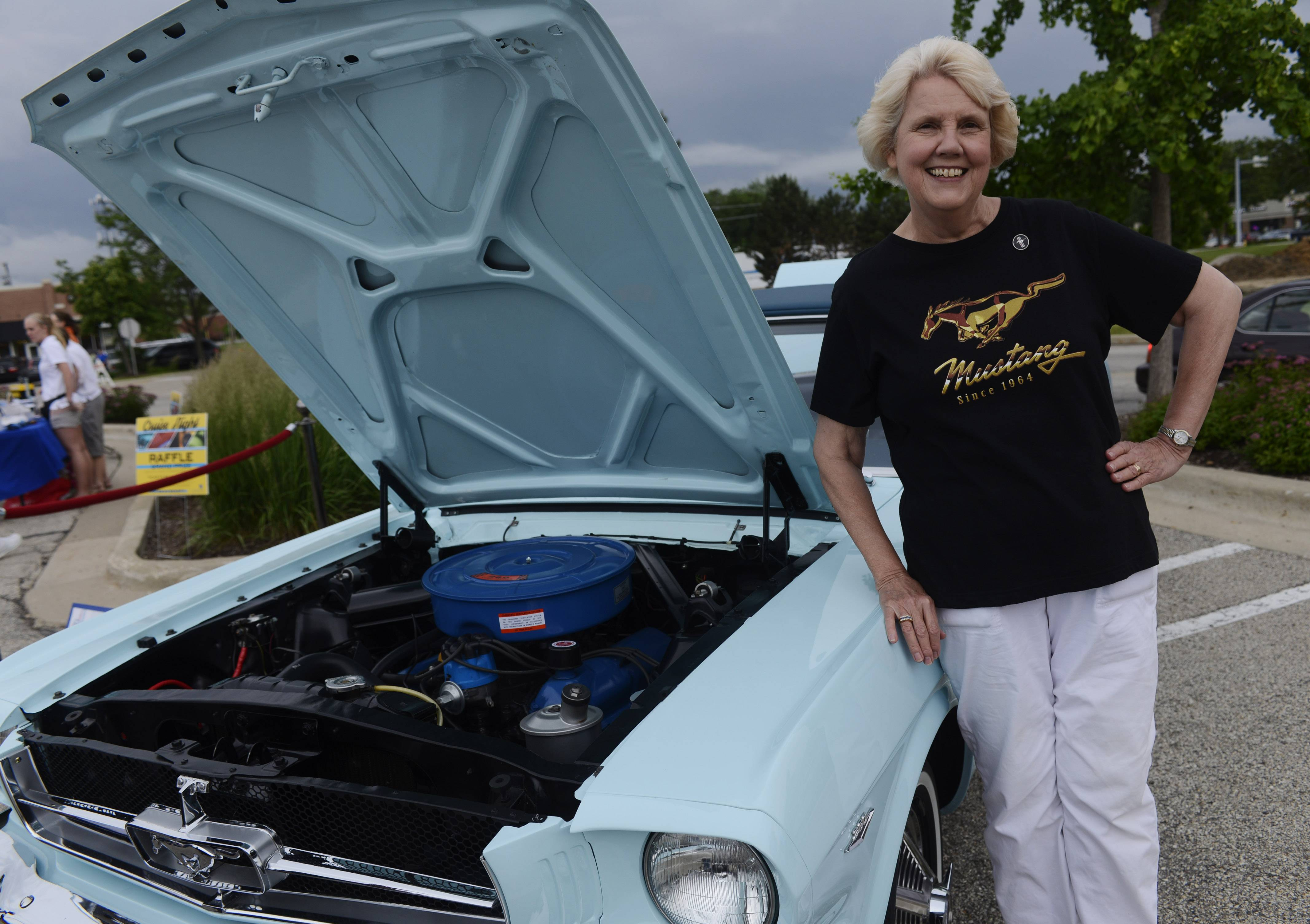 Gail Wise of Park Ridge stands with her historic 1964 1/2 Ford Mustang, which is the earliest such car known to be sold. Her famous car was one of those featured at the inaugural Cruise Night at Randhurst Village in Mount Prospect.