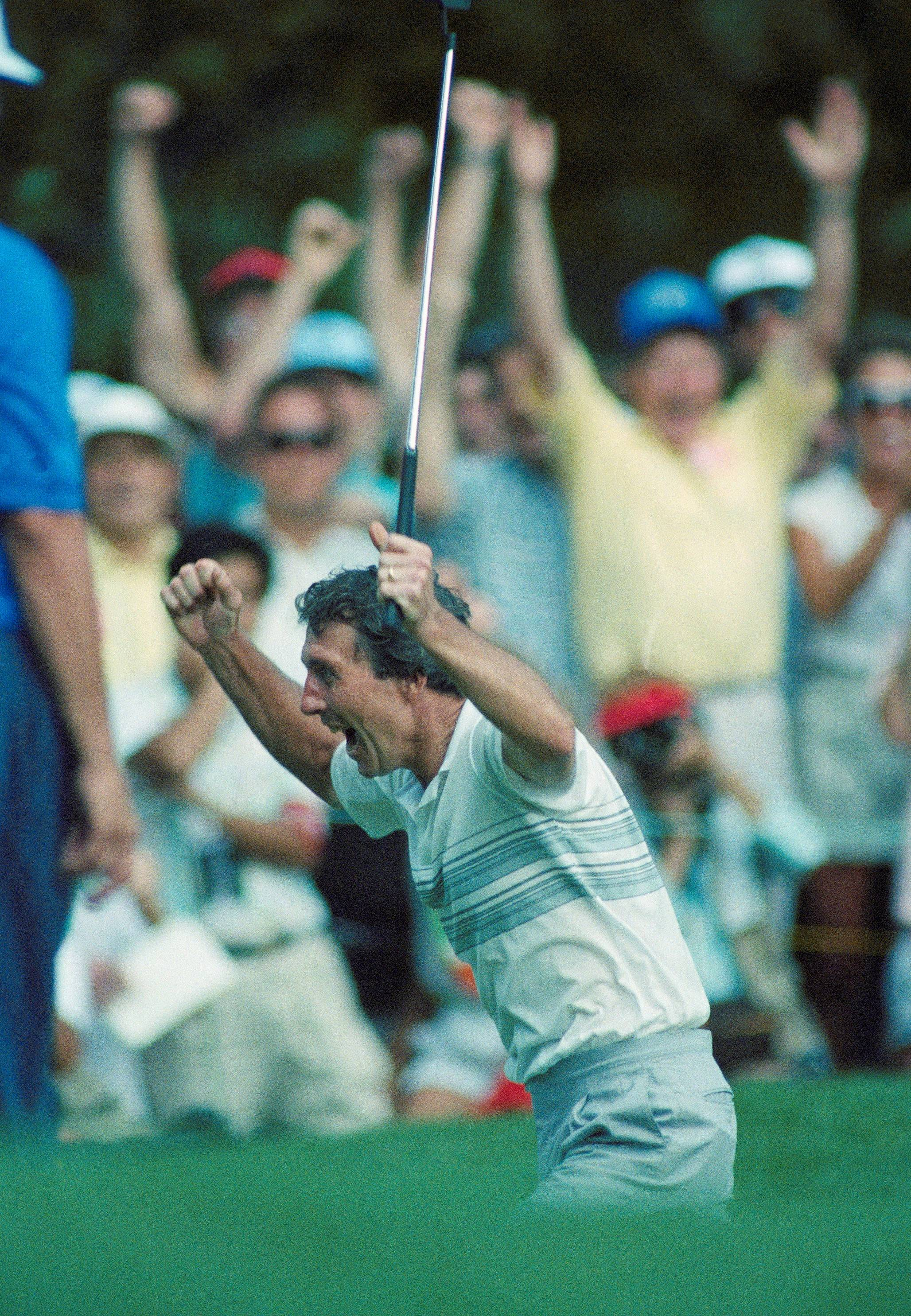 Hale Irwin jumps for joy after sinking a birdie putt on the 19th playoff hole Monday, June 18, 1990 with Mike Donald during the U.S. Open at Medinah Country Club in Medinah, Il.
