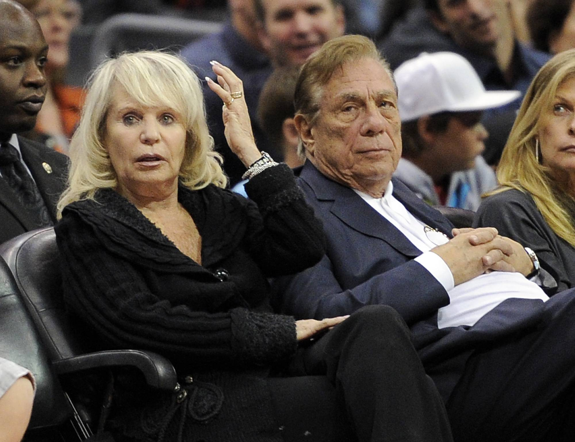 FILE - In this Nov. 12, 2010, file photo, Shelly Sterling sits with her husband, Donald Sterling, right, during the Los Angeles Clippers' NBA basketball game against the Detroit Pistons in Los Angeles. Shelly Sterling's attorneys have asked a court on Thursday June 19, 2014, to hold a hearing on allegations that Donald Sterling and his attorneys have threatened her legal team and the doctors who assert that the Los Angeles Clippers co-owner is mentally incapacitated.