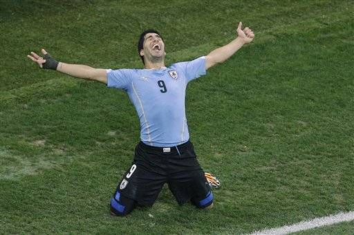 Uruguay's Luis Suarez celebrates scoring 2-1 during the group D World Cup soccer match between Uruguay and England at the Itaquerao Stadium in Sao Paulo, Brazil, Thursday