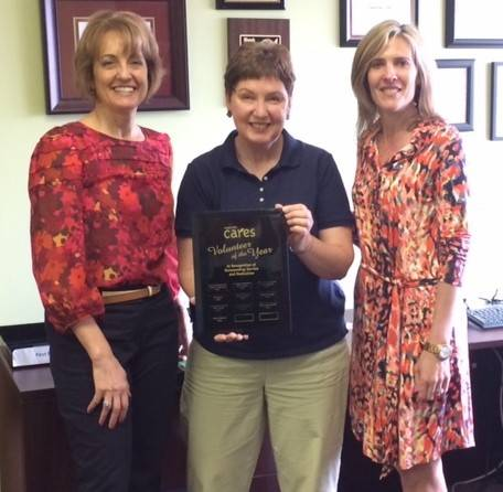 Mary Voiland, center, Naperville CARES' Volunteer of the Year, is congratulated by Executive Director Janet Derrick, left, and program manager Maria McTarnaghan.
