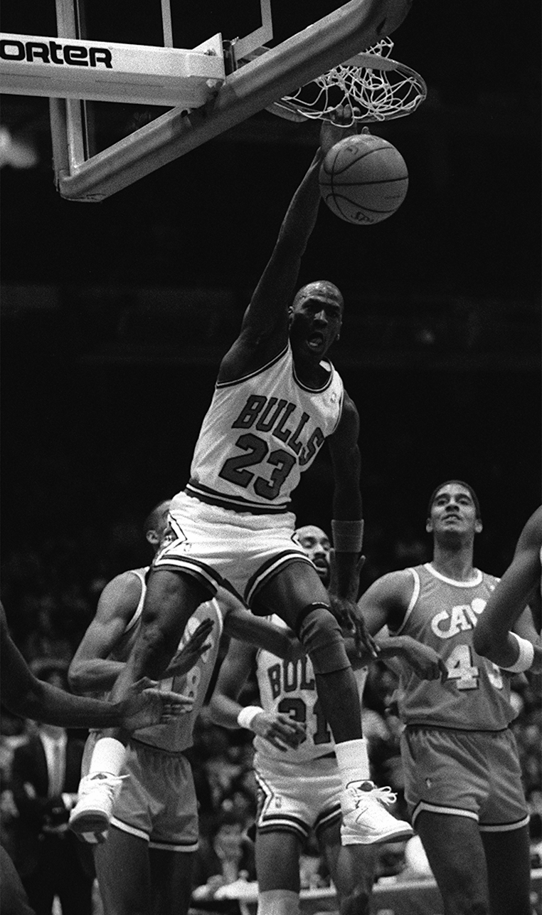 Michael Jordan slams the basketball during a game against the Cleveland Cavaliers.