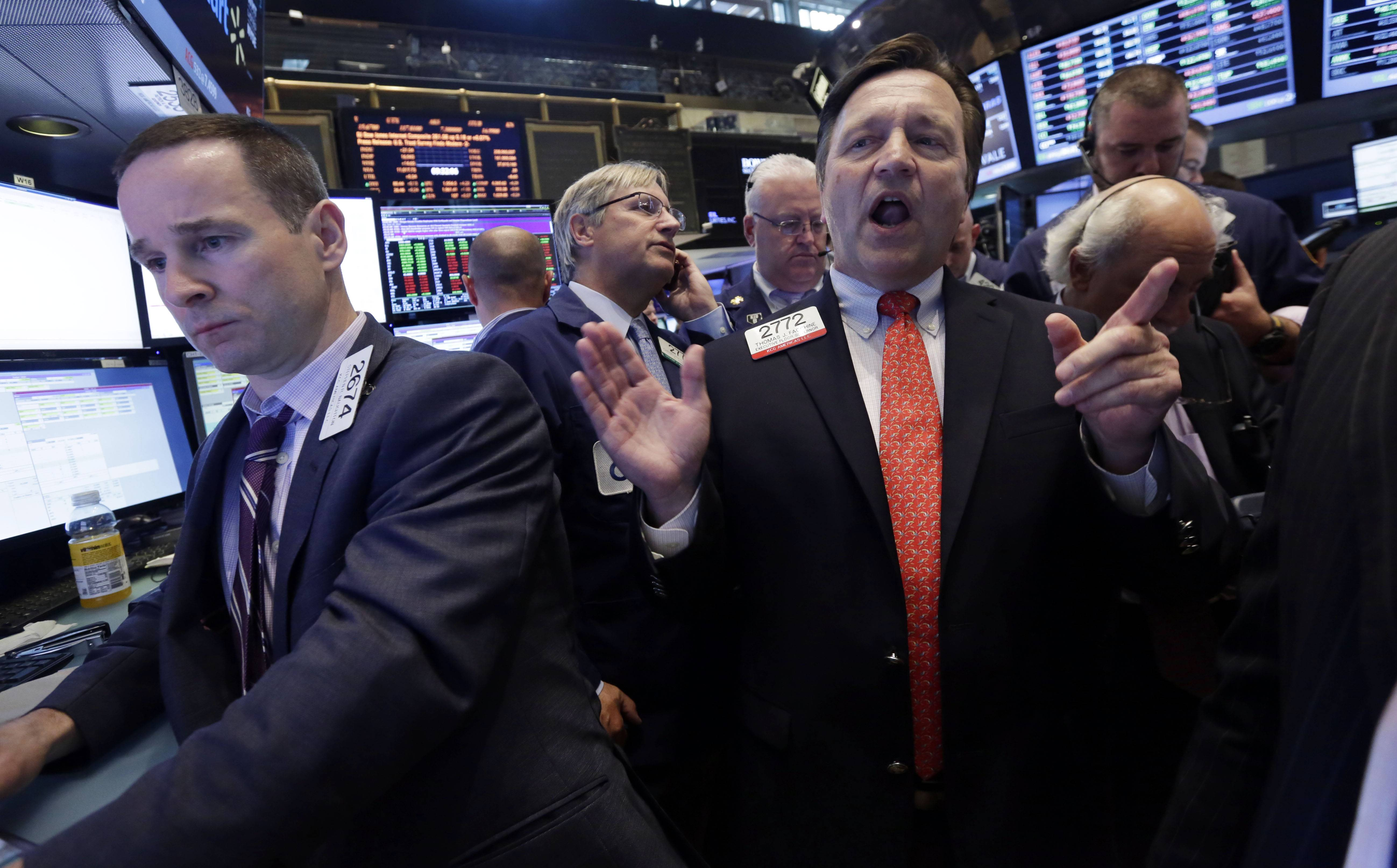 Specialist Thomas Facchine, right, calls out prices Friday during the IPO of Eclipse Resources Corp. on the floor of the New York Stock Exchange.