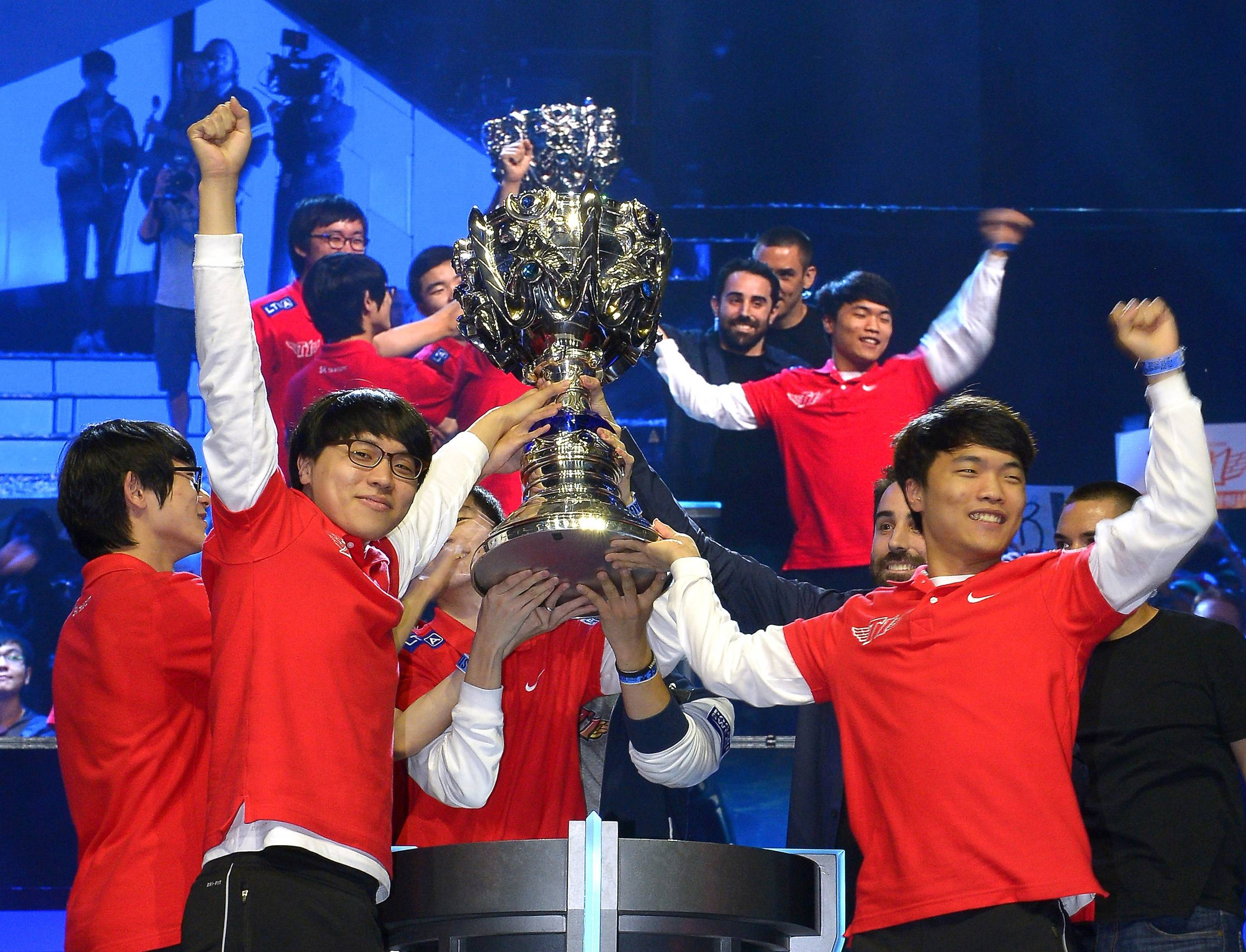 Members of Korea's SK Telecom T1 team celebrate with their trophy after defeating China's Royal Club at the League of Legends Season 3 World Championship Final last October in Los Angeles.
