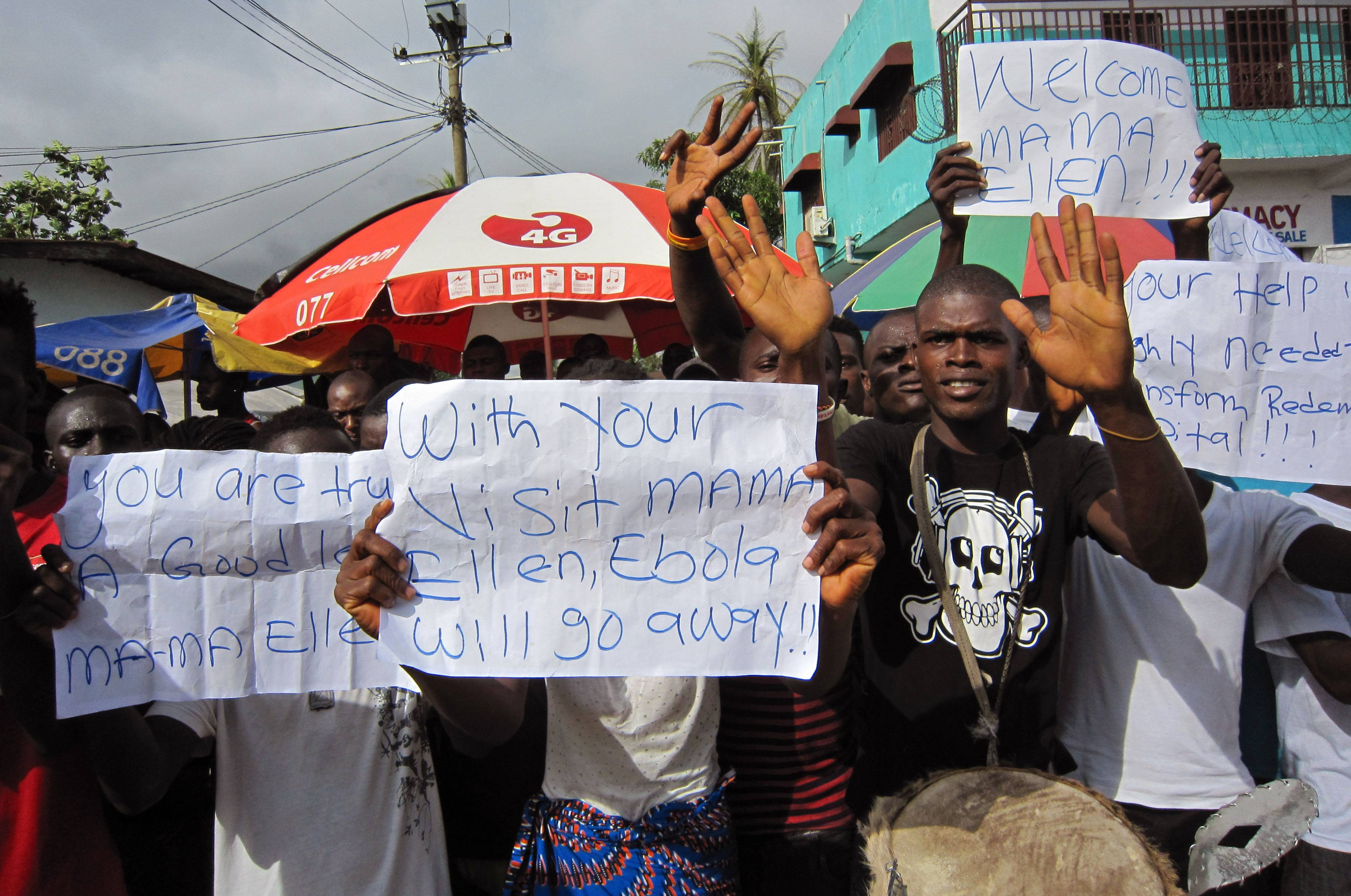 People protest outside a hospital as Liberia President Ellen Johnson Sirleaf visits the area Tuesday after Ebola deaths in Monrovia, Liberia.