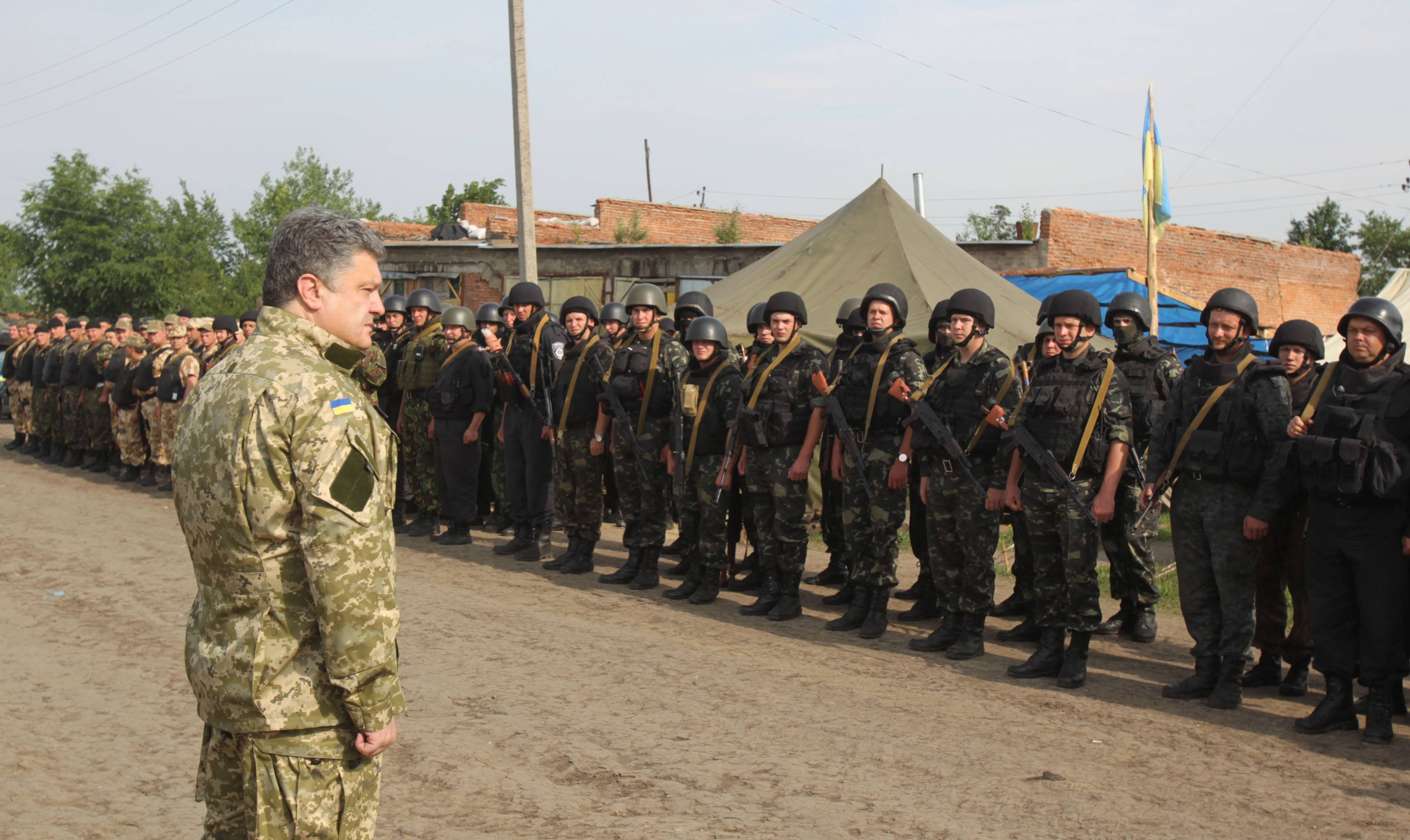 Ukrainian President Petro Poroshenko talks Friday with Ukrainian soldiers at a military base close to Slovyansk, in the Donetsk region, Ukraine.