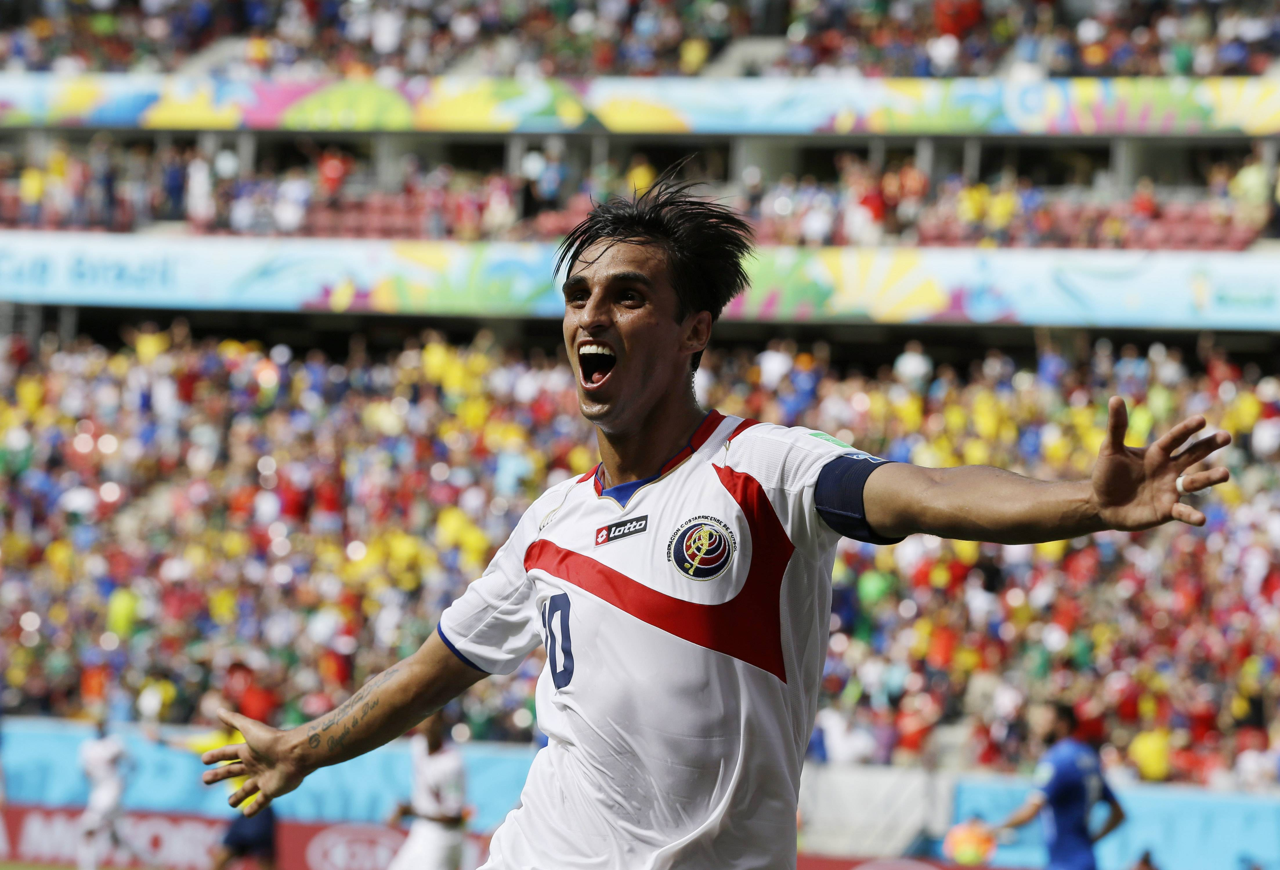 Costa Rica's Bryan Ruiz celebrates after scoring his side's first goal over Italy's goalkeeper Gianluigi Buffon during the group D World Cup soccer match between Italy and Costa Rica at the Arena Pernambuco in Recife, Brazil, Friday, June 20, 2014. (AP Photo/Ricardo Mazalan)