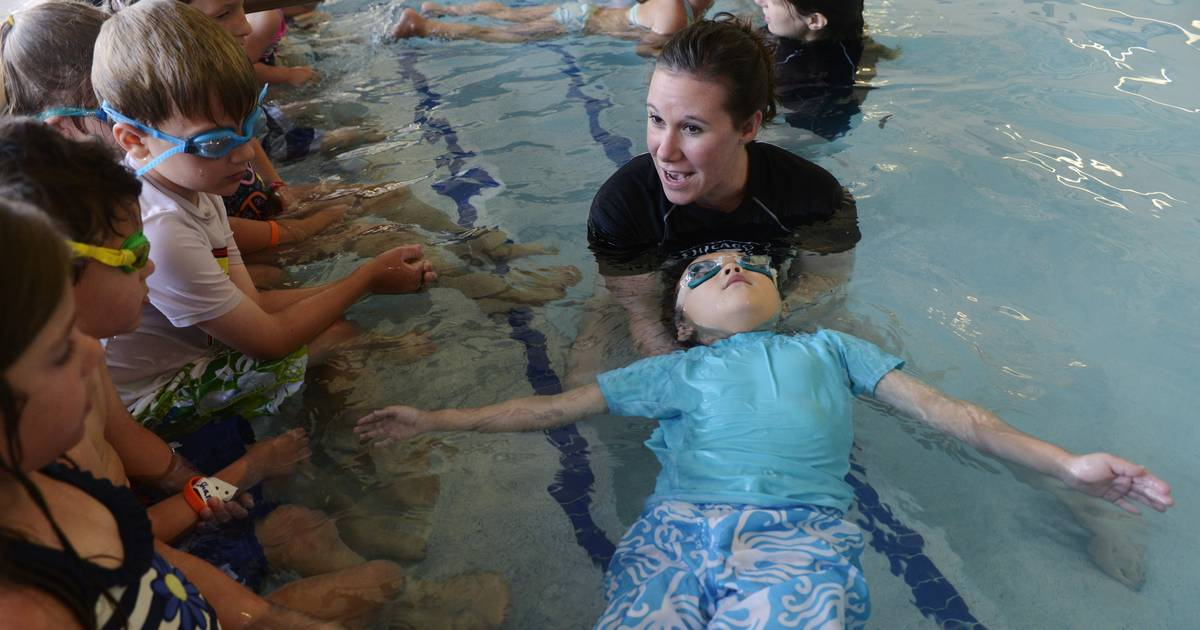 suburbs part of try to set record for world 39 s largest swimming lesson
