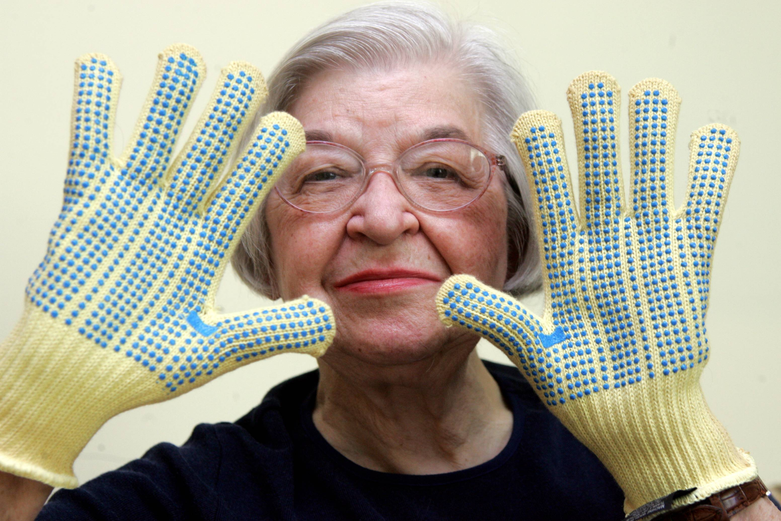 Stephanie Kwolek, 83, wears regular house gloves made with the Kevlar she invented.