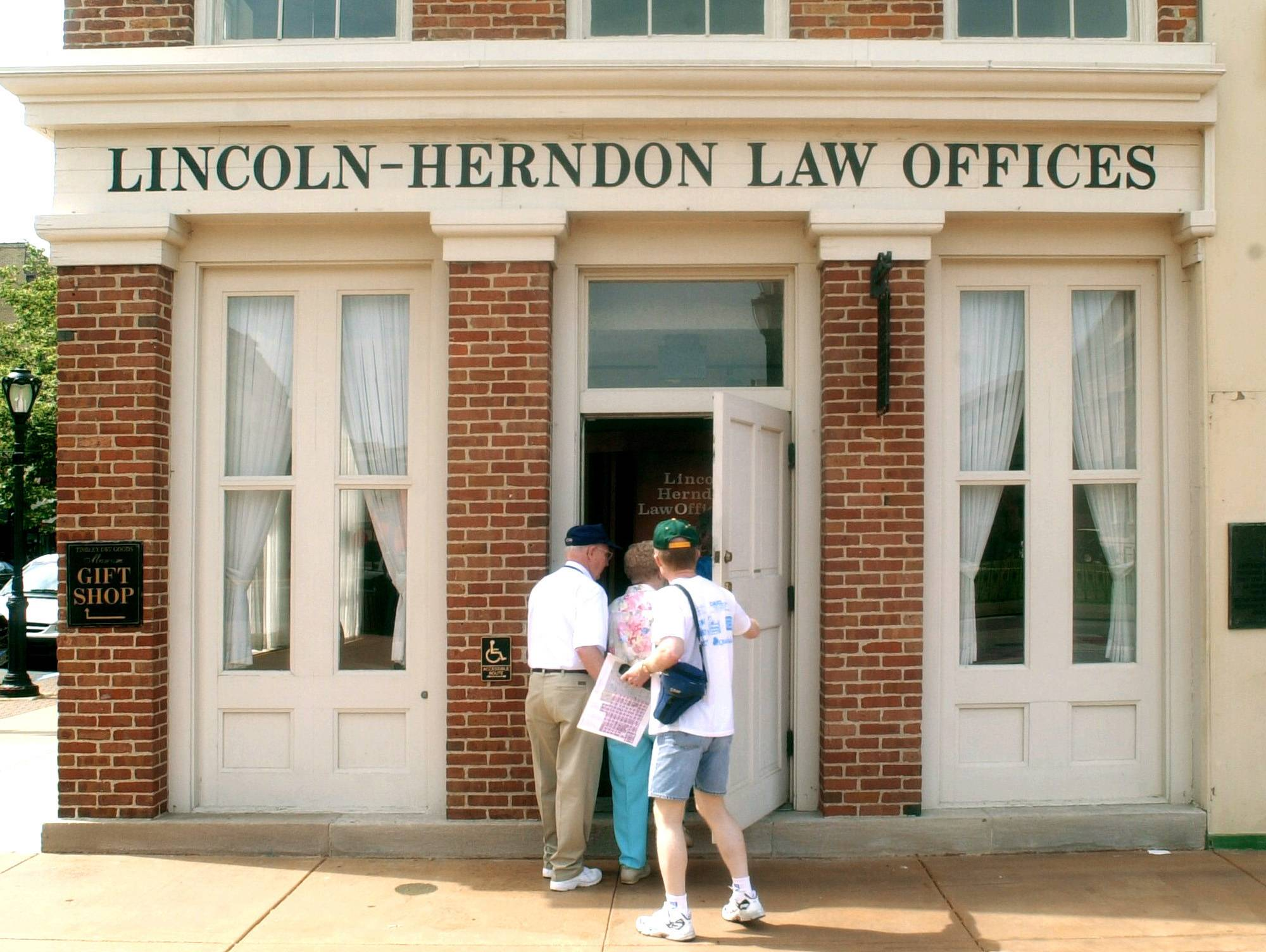 Tourists enter the Lincoln-Herndon Law Offices in Springfield, where Abraham Lincoln practiced law from 1843 to 1852.