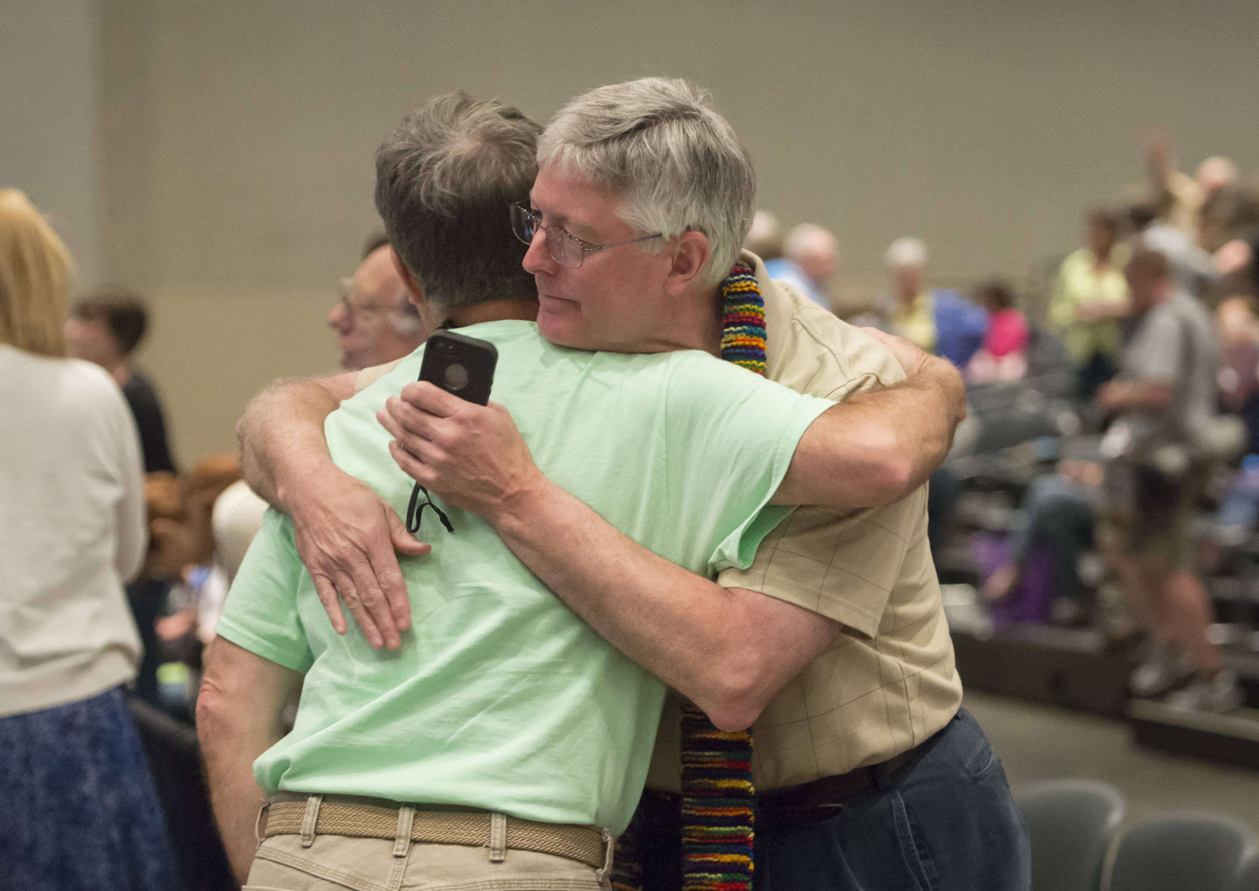 "Gary Lyon, of Leechburg, PA, left, and Bill Samford, of Hawley, PA., celebrate after a vote allowing Presbyterian pastors discretion in marrying same-sex couples at the 221st General Assembly of the Presbyterian Church at Cobo Hall, in Detroit, Thursday, June 19, 2014. The top legislative body of the Presbyterian Church (U.S.A.) voted by large margins to recognize same-sex marriage as Christian in the church constitution, adding language that marriage can be the union of ""two people,"" not just ""a man and a woman."""