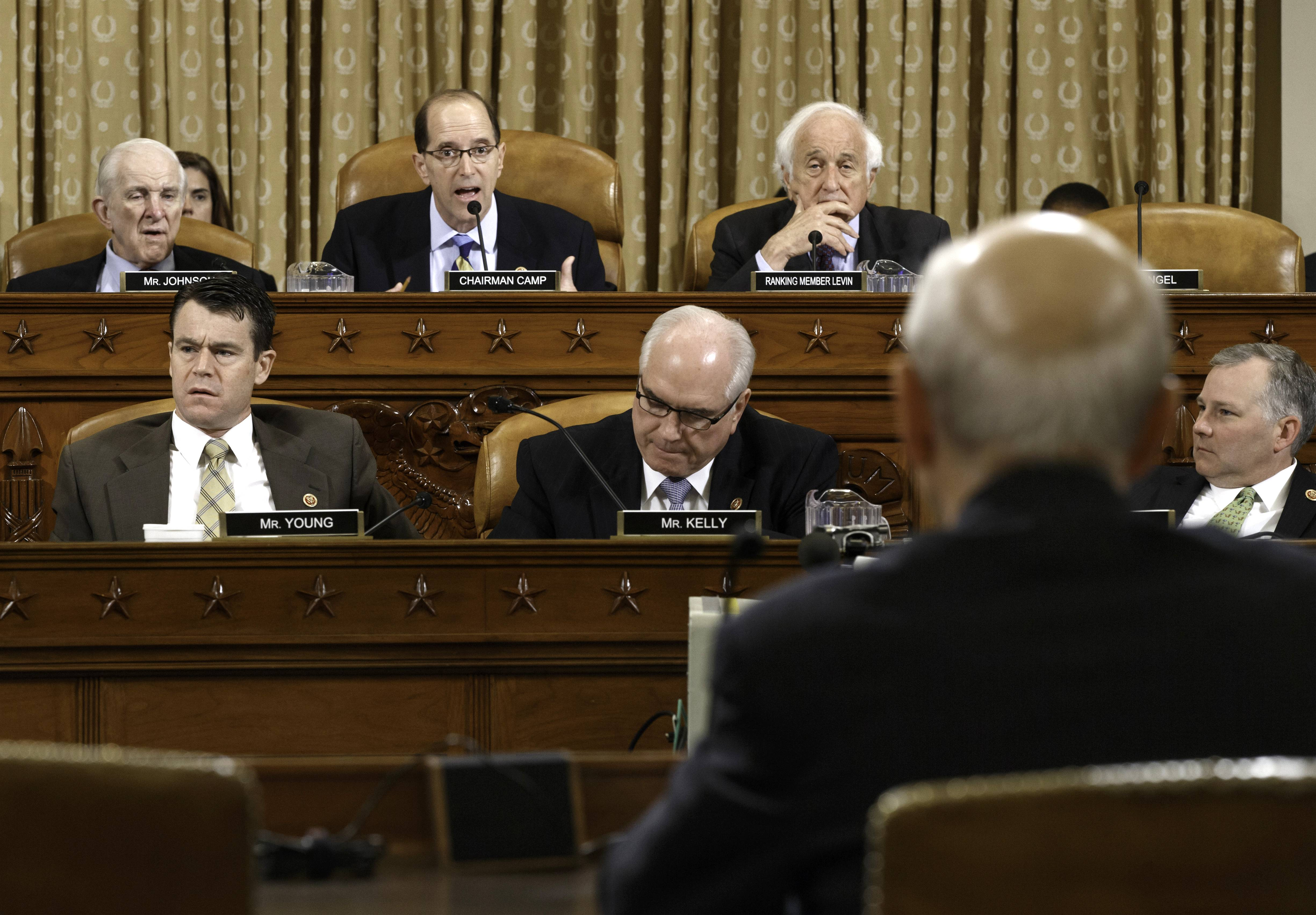 House Ways and Means Committee Chairman Rep. Dave Camp, R-Mich., center, flanked by the committee's ranking member Rep. Sander Levin, D-Mich., right, and Rep. Sam Johnson, R-Texas, questions Internal Revenue Service (IRS) Commissioner John Koskinen in the continuing probe of whether Tea Party groups were improperly targeted for increased scrutiny by the IRS.