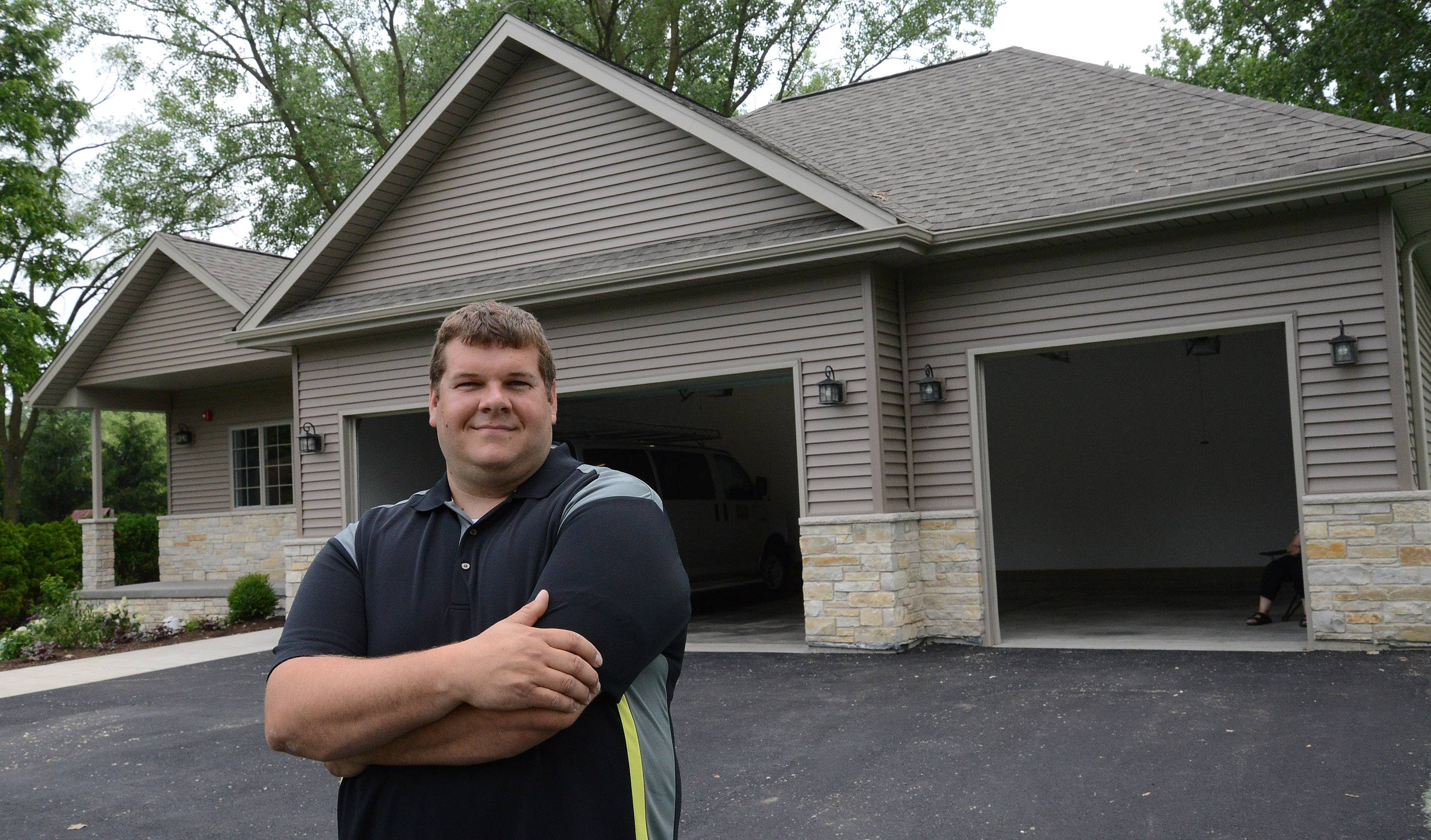 Marc Sears, PAC instructor for District 214, stands in front of the four-bedroom, 2½-bath Prospect Heights home students recently completed. The house is expected to go on the market in July.