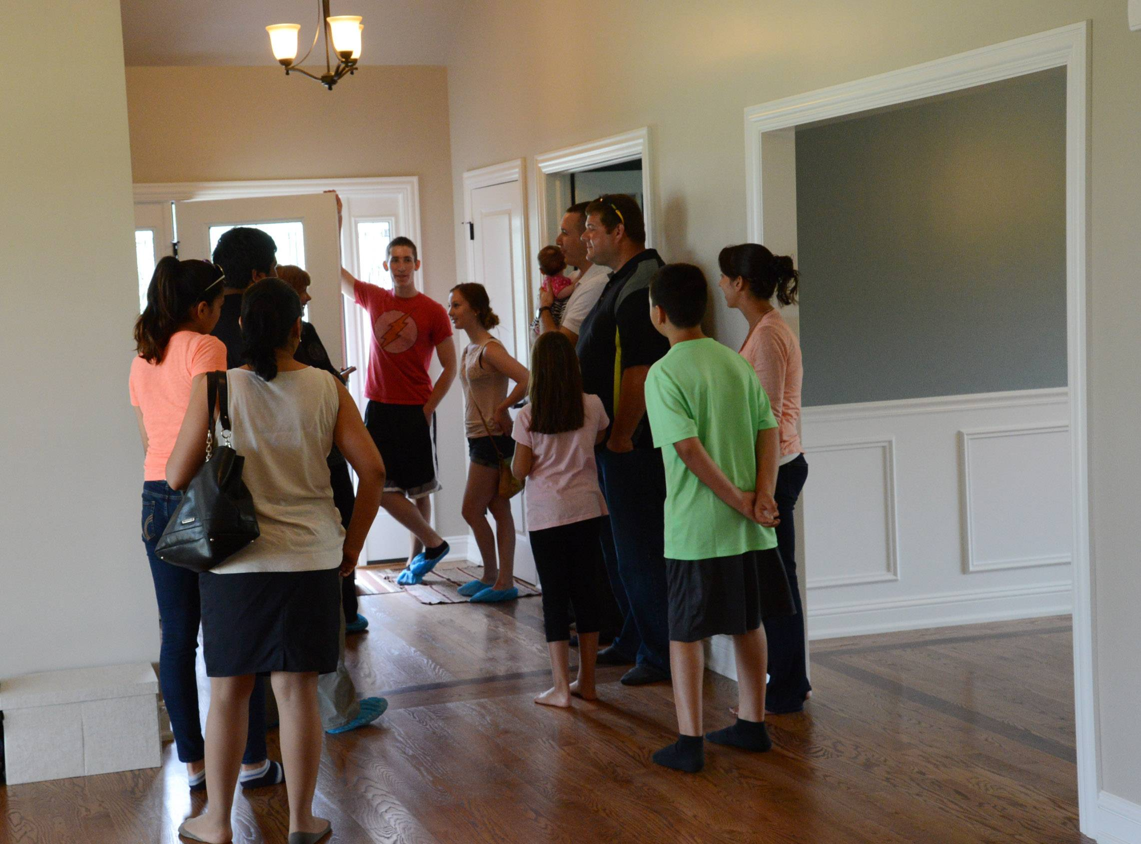 Students and instructors from District 214's Practical Architectural Construction course hosted an open house Thursday for the four-bedroom, 2½-bath Prospect Heights home they built. The house is expected to go on the market in July.