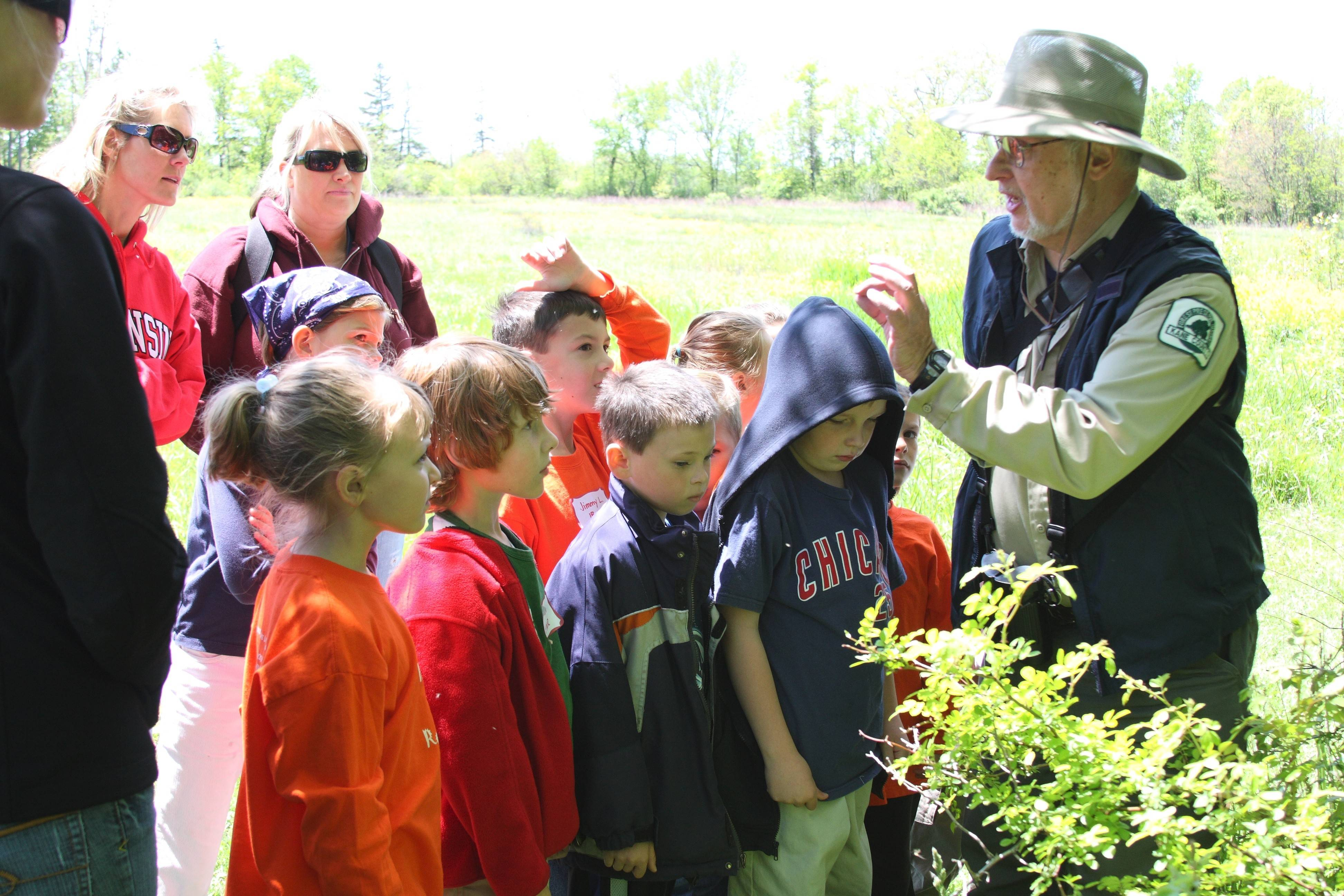 Naturalist Jack Pomatto leads participants on a wildflower hike. He was known for his ability to connect with nature lovers of all ages.