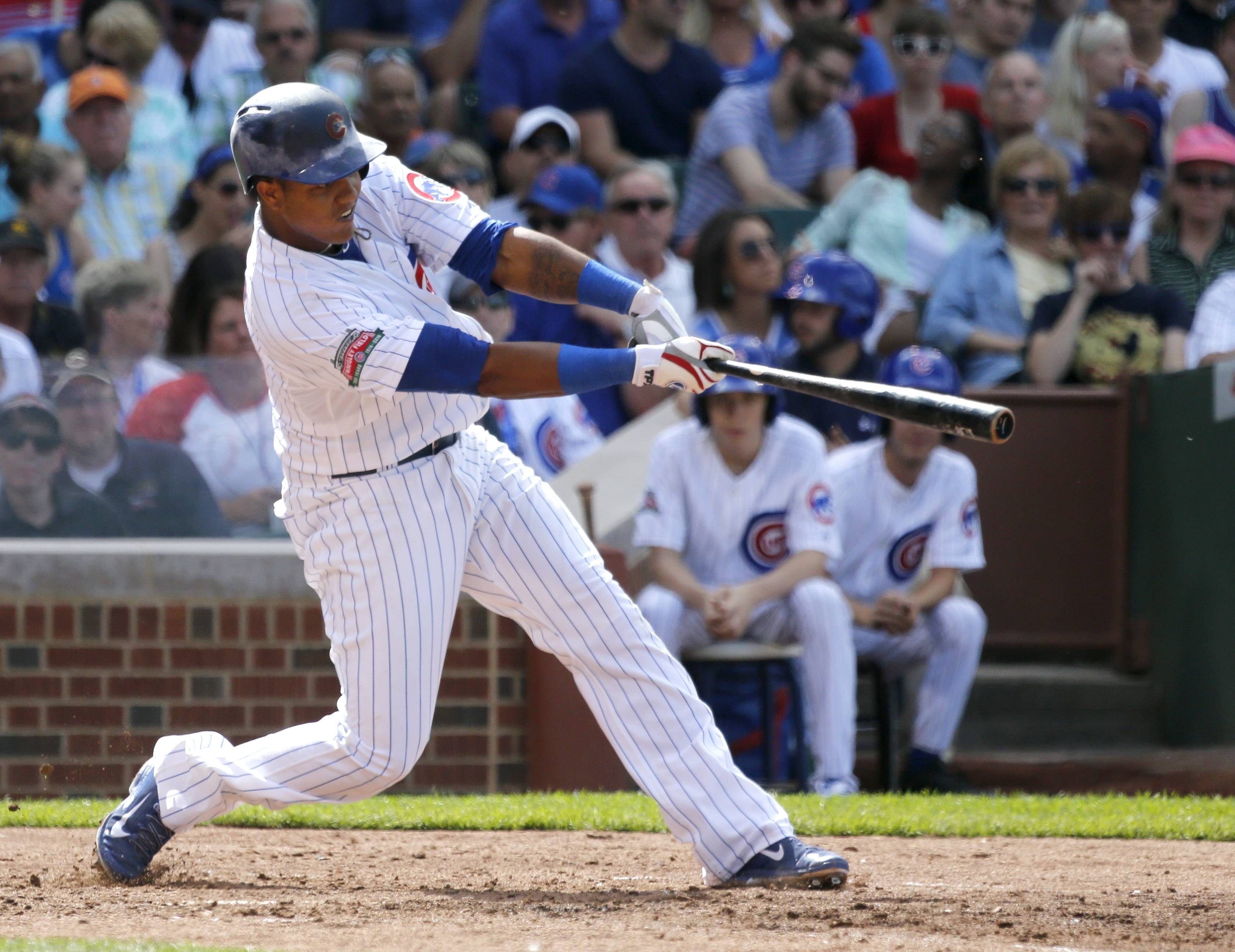 Starlin Castro hits a 3-run home run off Pirates starter Charlie Morton during the third inning Friday at Wrigley Field. It was Castro's 11th homer in the Cubs' 71st game, eclipsing his total of 10 in all of 2013.