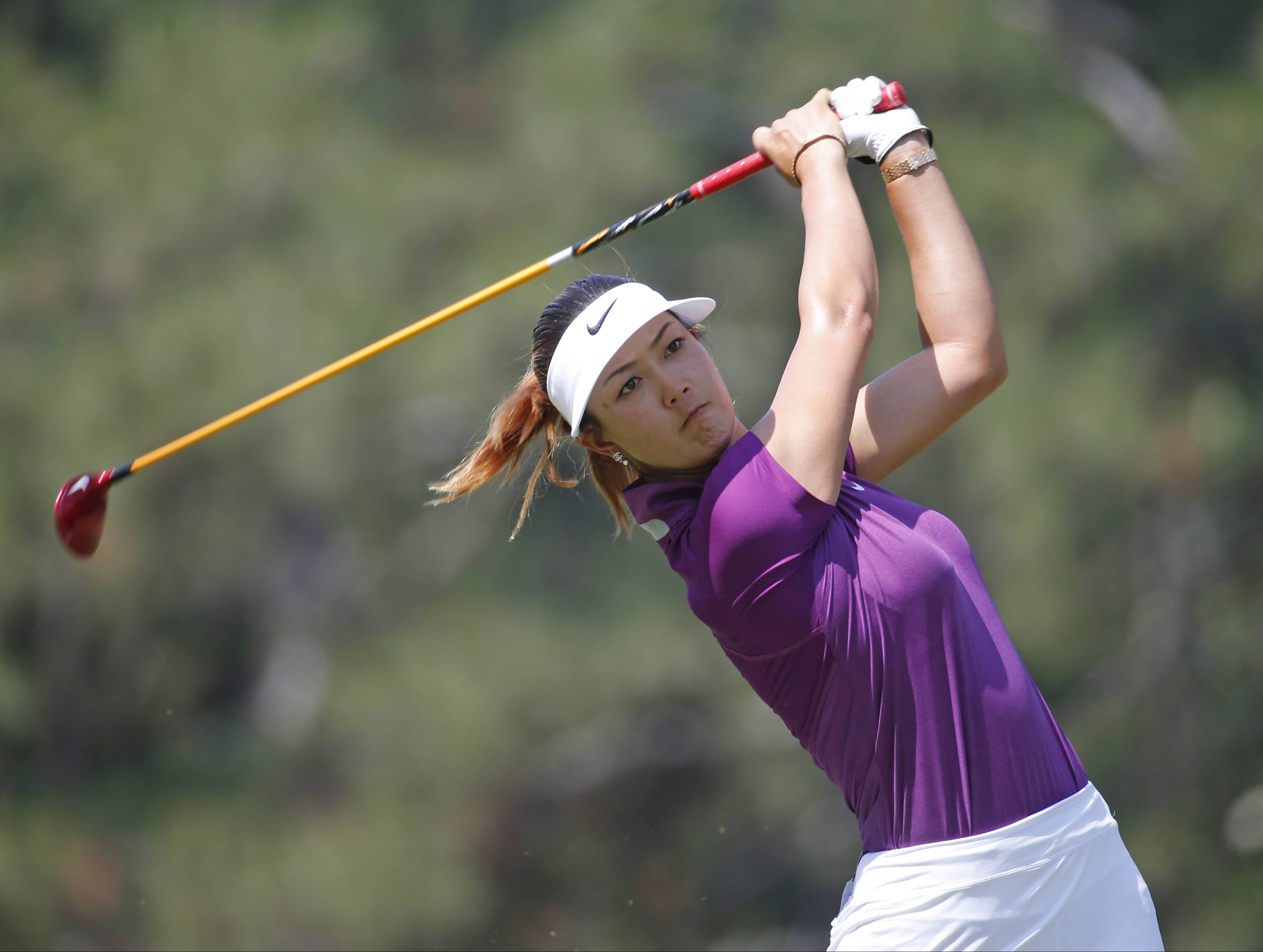 Michelle Wie watches her tee shot  on the second hole during the second round of the U.S. Women's Open golf tournament in Pinehurst, N.C., Friday, June 20, 2014.