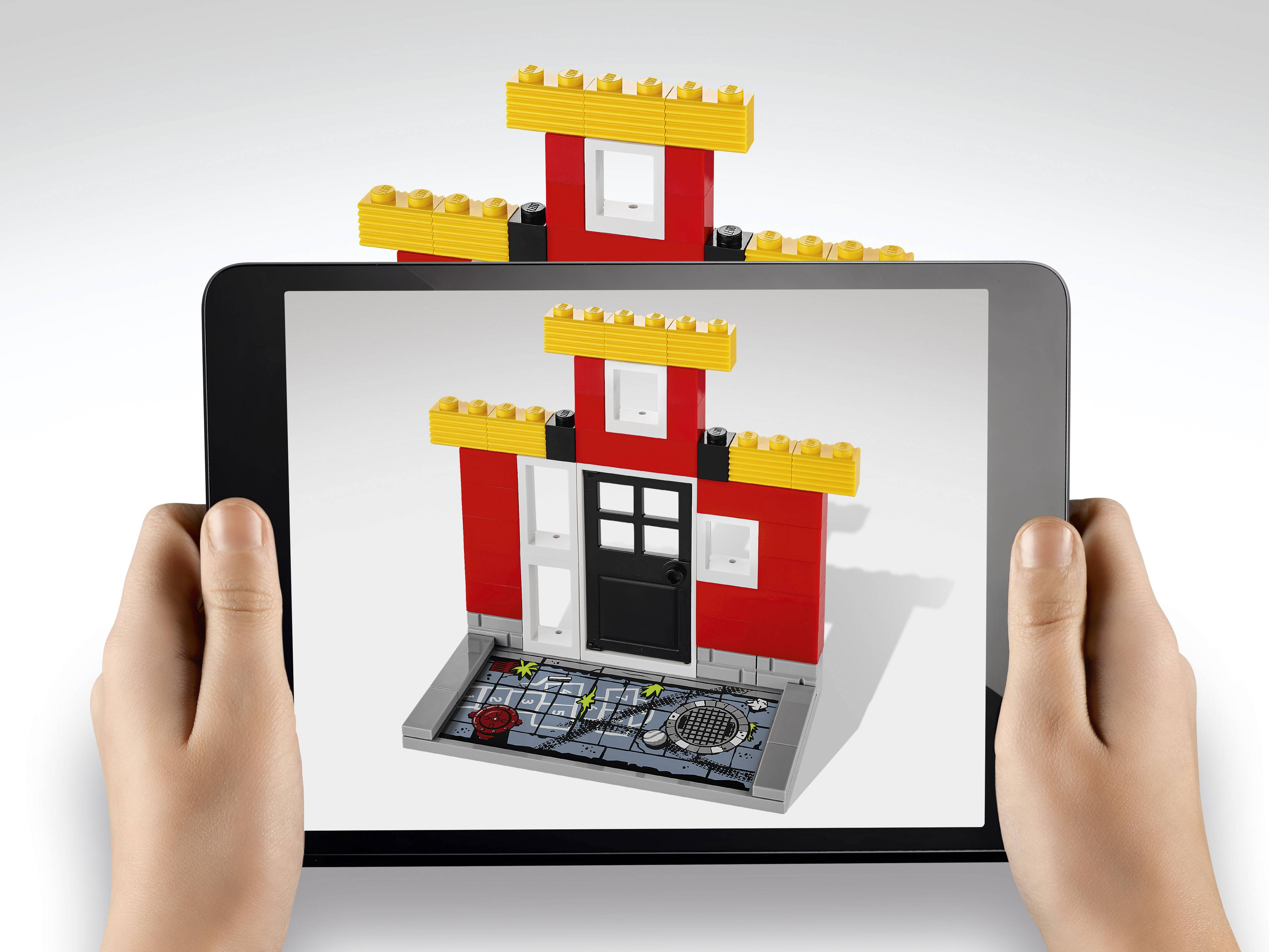 This undated image provided by Lego shows a version of the Lego Fusion line, a play experience that combines traditional Lego brick play with familiar app-based game themes.
