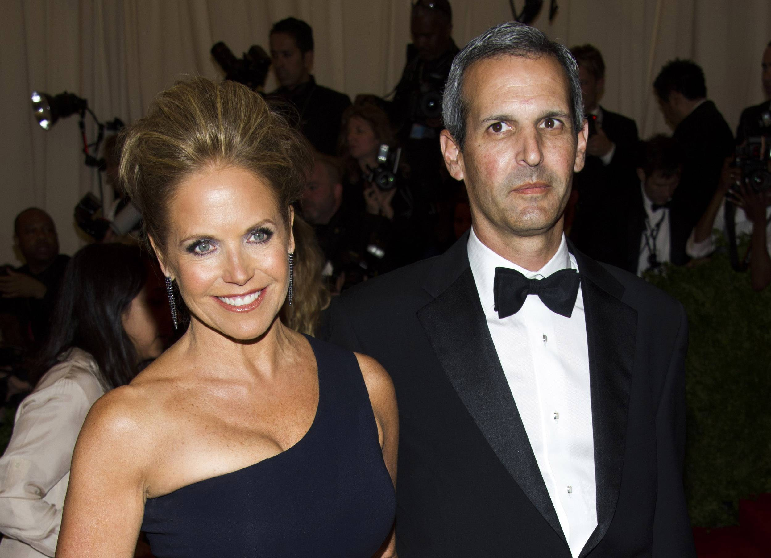 "In this May 6, 2013, file photo, TV personality Katie Couric and John Molner attend The Metropolitan Museum of Art's Costume Institute benefit celebrating ""PUNK: Chaos to Couture"" in New York. Couric has married Molner in a small ceremony at her East Hampton home. People magazine reports the former ""Today"" host and Molner took the vows on Saturday in front of 50 guests."
