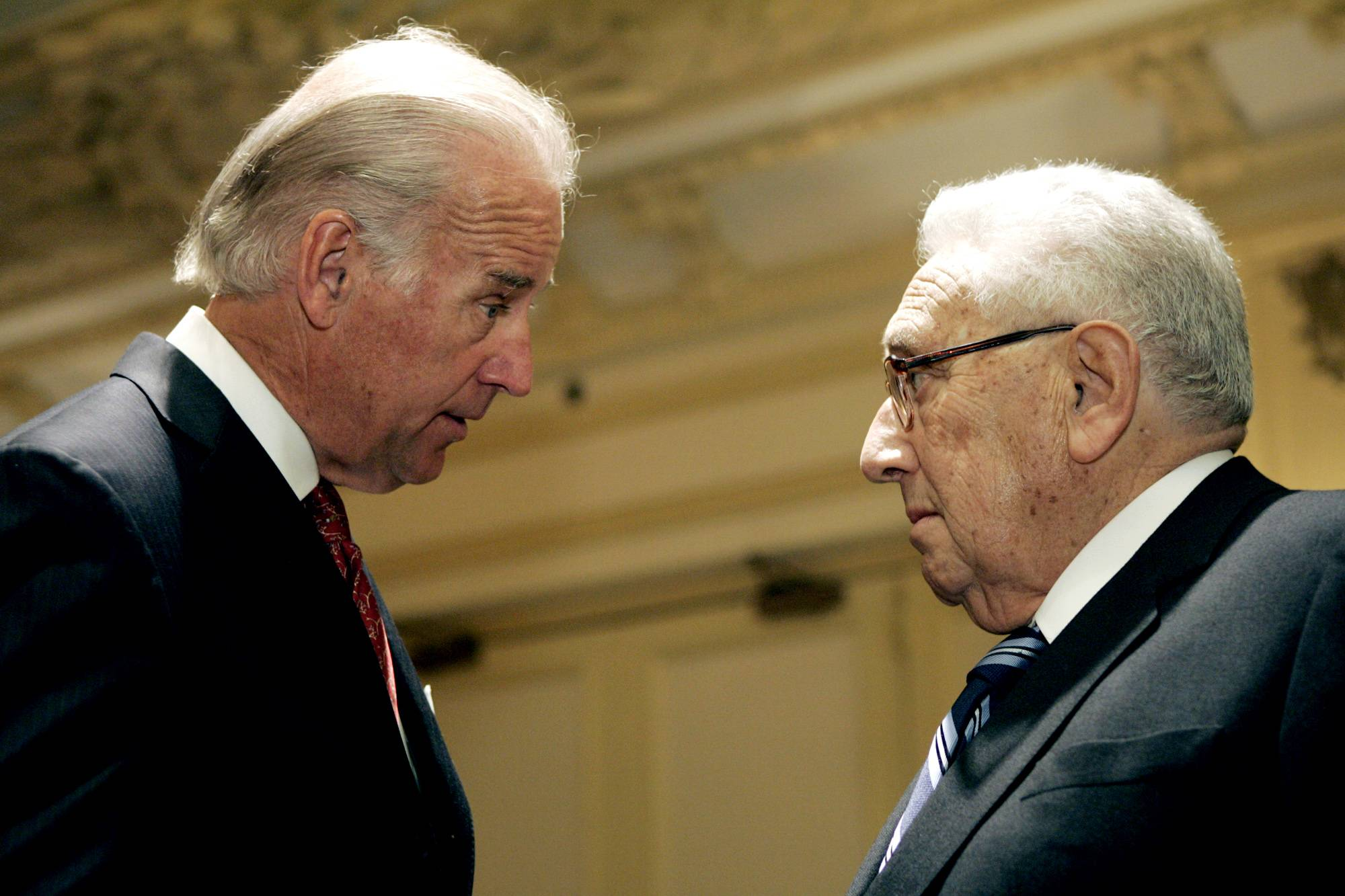 Then-Sen. Joseph Biden, D-Del., left, speaks with former Secretary of State Henry Kissinger, after he gave a speech proposing that Iraq be divided into three separate regions during the World Affairs Council of Philadelphia conference in Philadelphia.