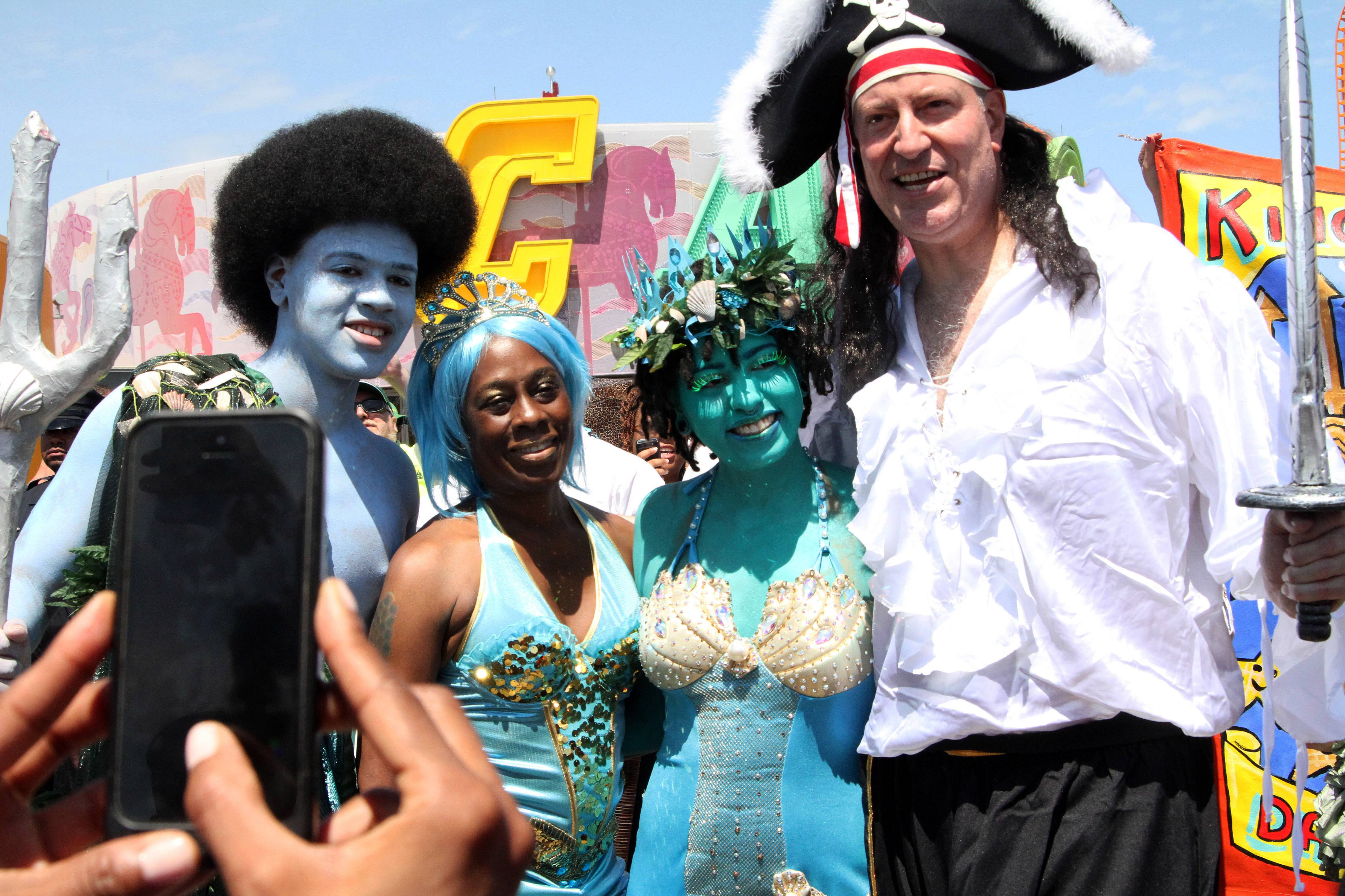 Mayor Bill de Blasio, right, and his wife Chirlane McCray, second from left, pose for a photograph Saturday with their children Dante de Blasio, left, and Chiara de Blasio as they take part in the Mermaid Parade in the Coney Island section of the Brooklyn borough of New York.