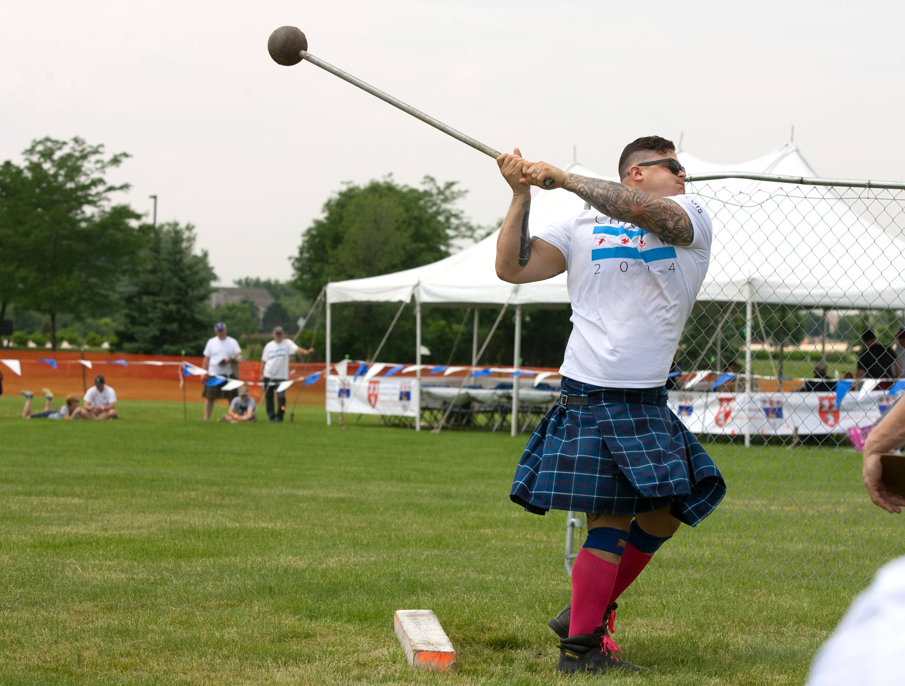 Matt Vincent of Baton Rouge, Louisiana, launches a 22-pound hammer during the Scottish Festival and Highland Games at Hamilton Lakes in Itasca.