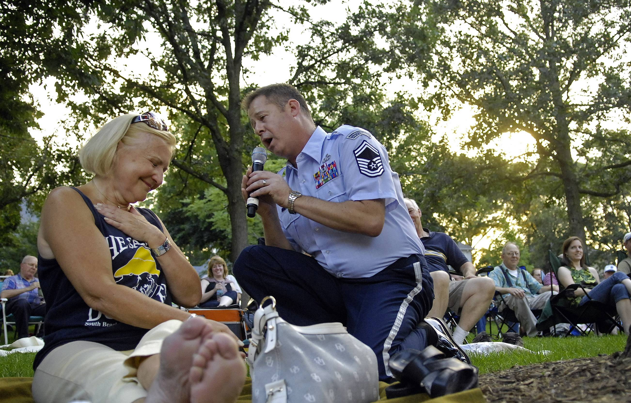 Natalie Woodward of Geneva is touched as Senior Master Sgt. Steve Thulon serenades her while the U.S. Air Force Band plays the Concert in the Park series in 2010 at Lincoln Park in St. Charles.