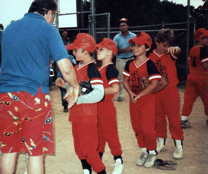 Antioch Youth Little League players receive trophies in 1988.
