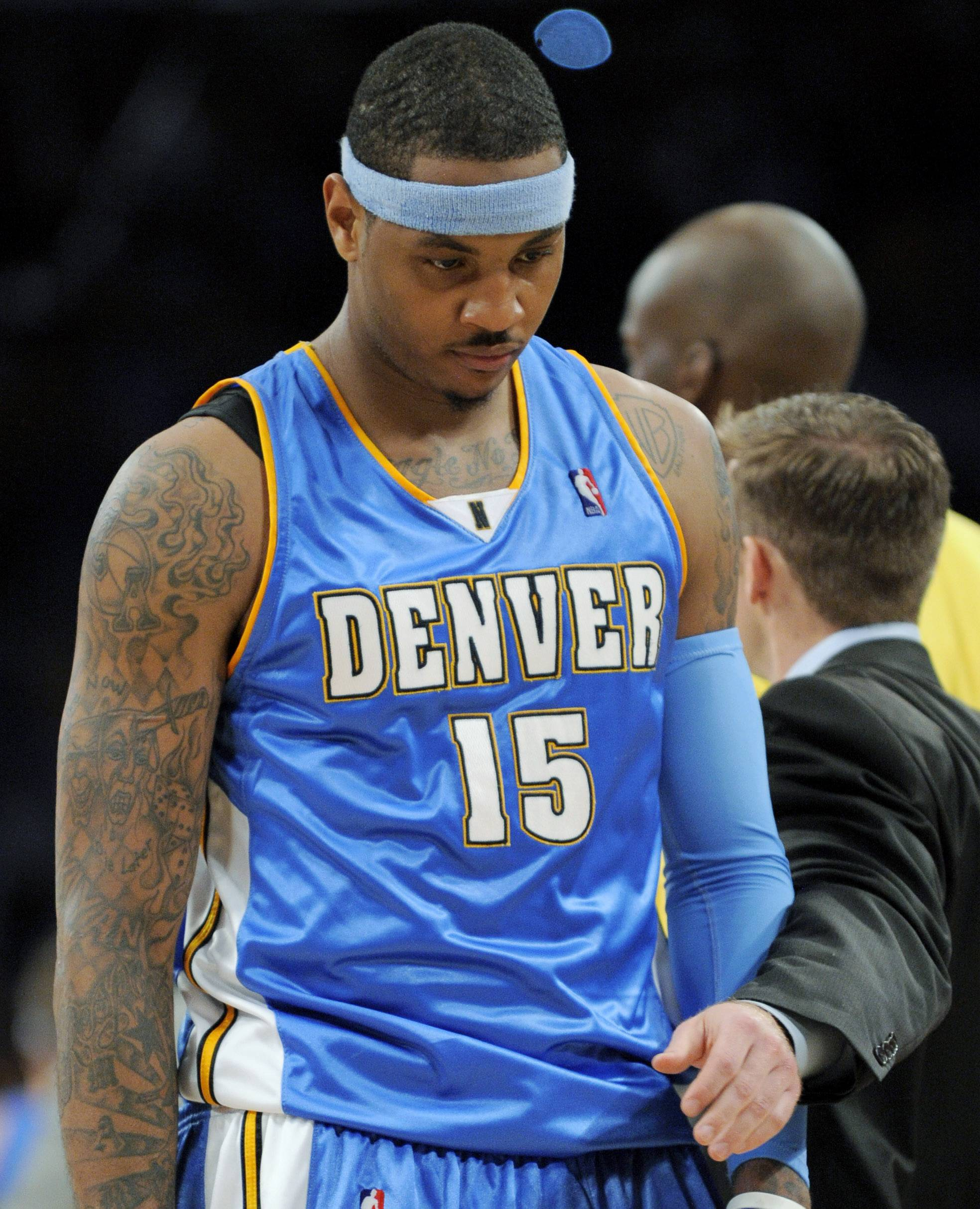 For the Bulls to acquire Carmelo Anthony, shown here with Denver in 2009, they'll have to make some tough decisions with their draft picks this week.