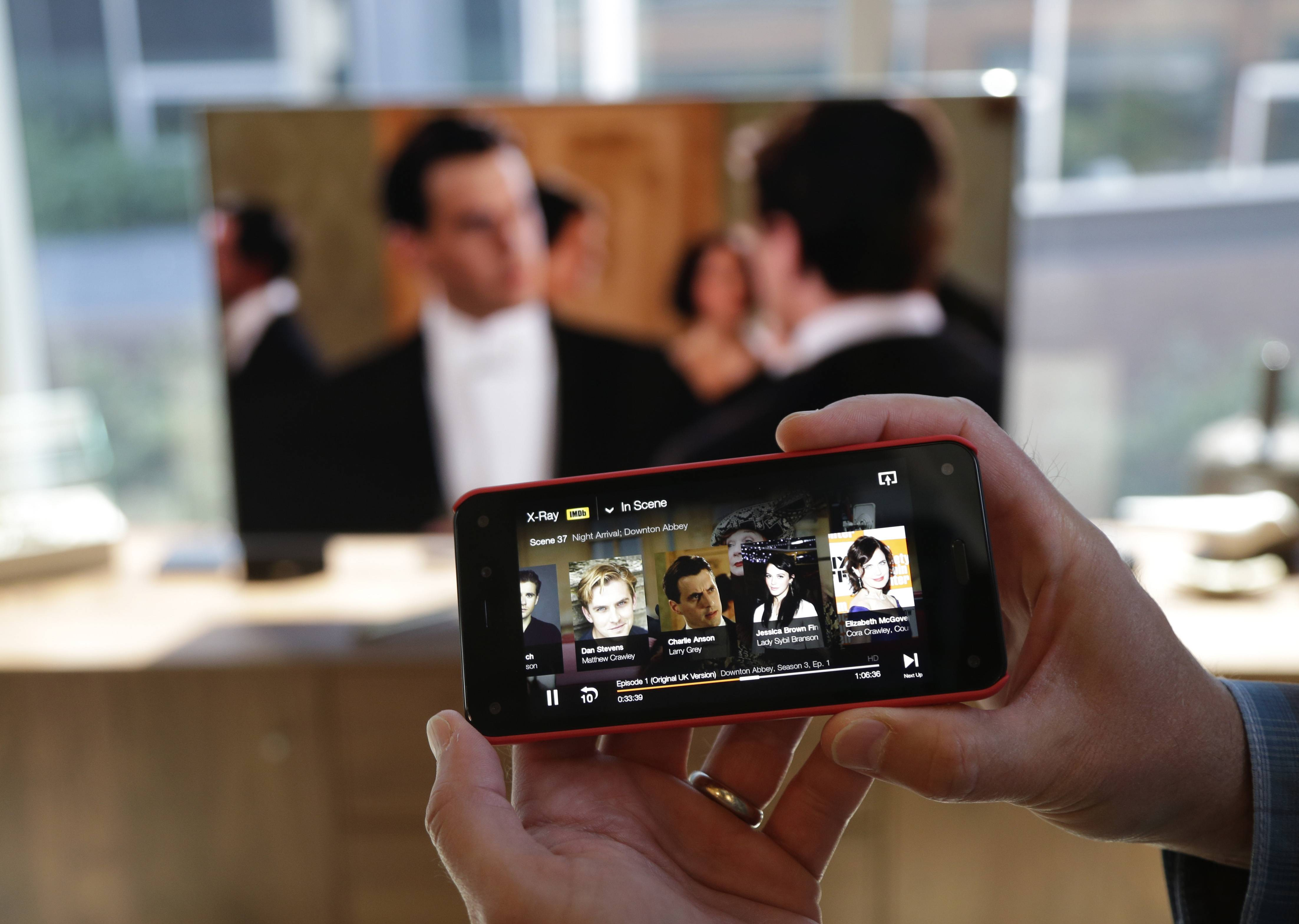 "The feature that lets the new Amazon Fire Phone send a movie or TV show wirelessly to a compatible television while the phone serves as a ""second screen"" to display information about actors, locations, and scenes is shown, Wednesday, June 18, 2014, in Seattle."