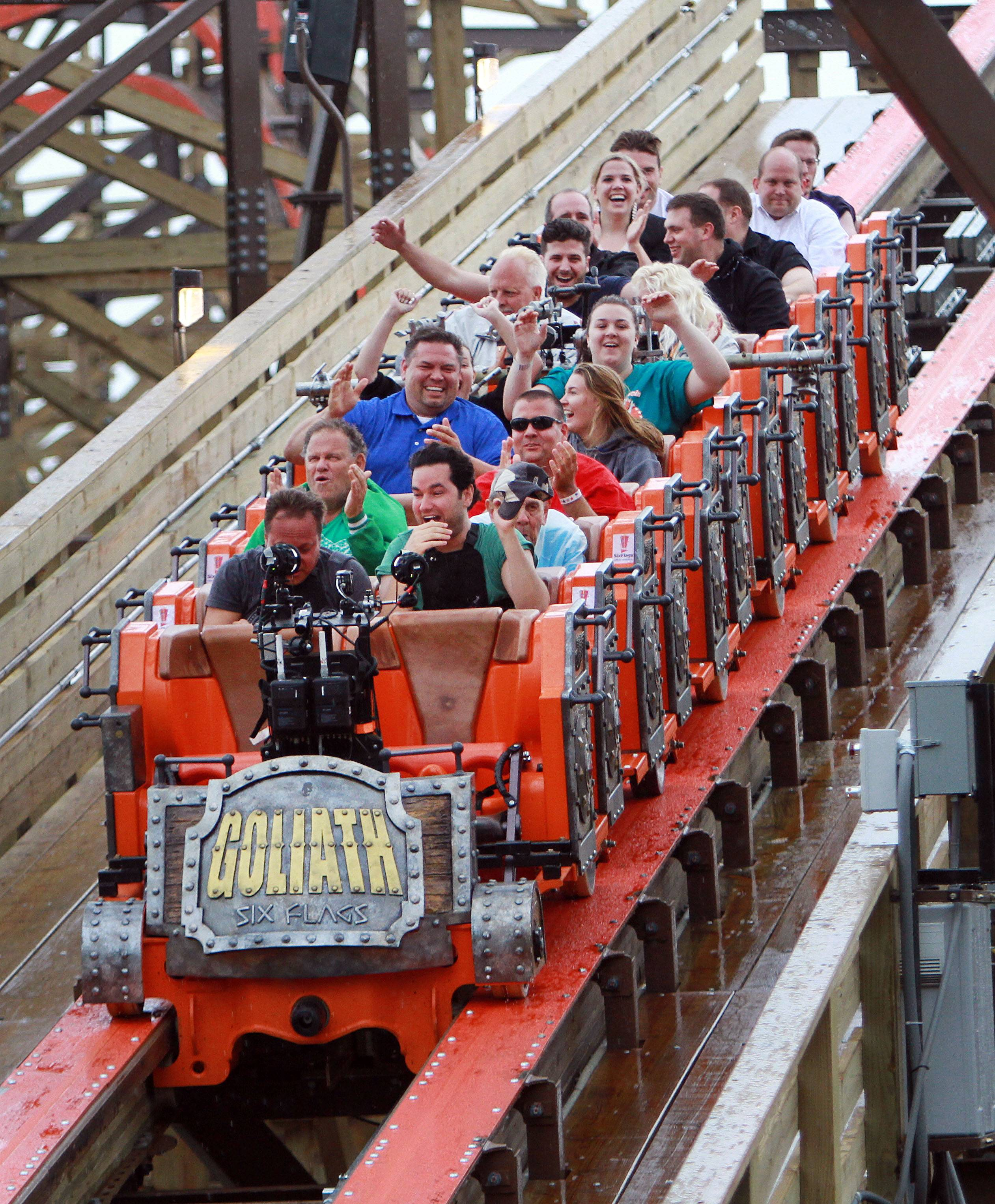 Steve Lundy/slundy@dailyherald.comRiders look excited after experiencing the new wooden roller coaster Goliath at Six Flags Great America in Gurnee Wednesday.