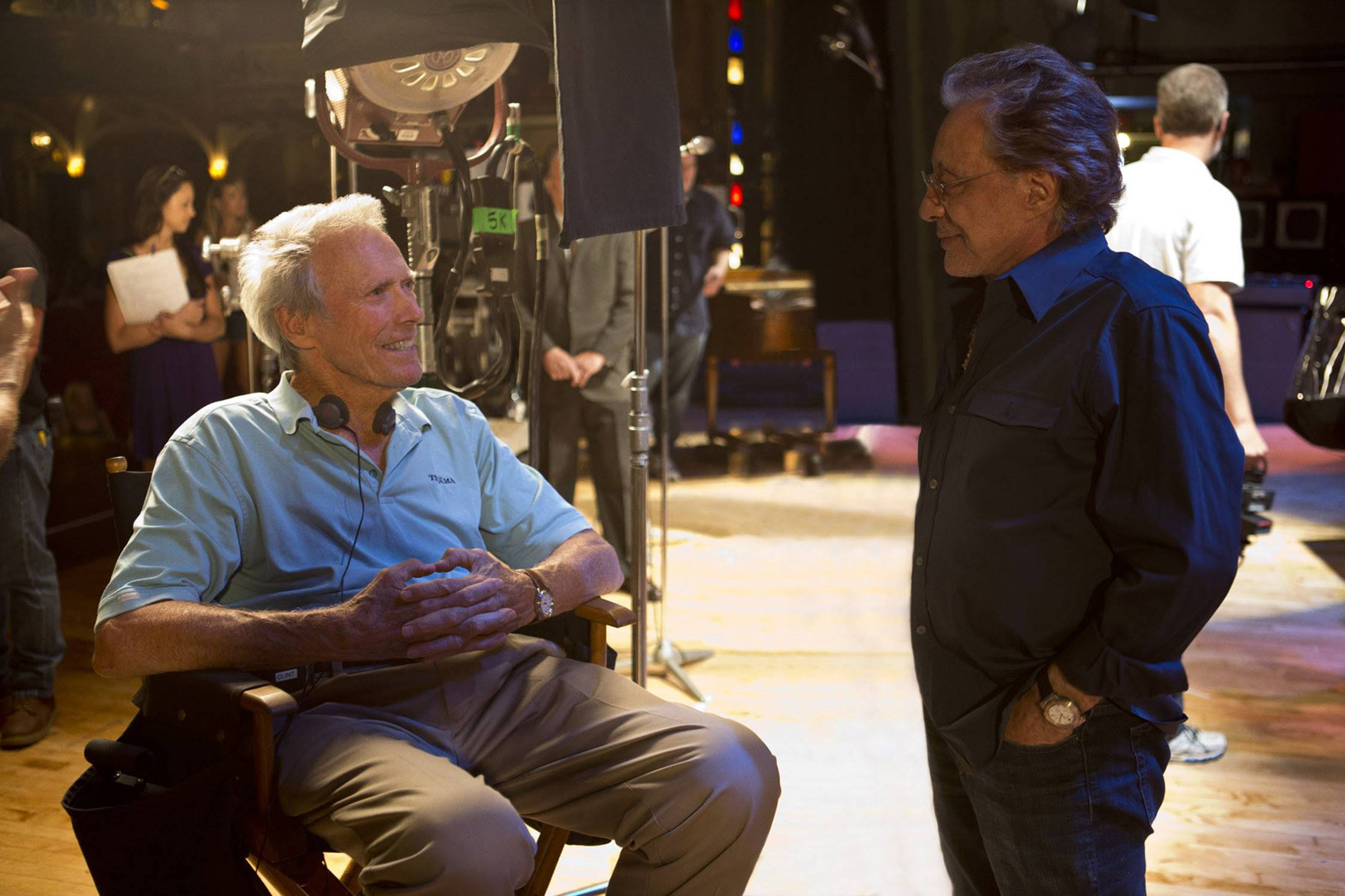 "Director/producer Clint Eastwood, left, discusses ""Jersey Boys"" with executive producer Frankie Valli on the set of the big-screen adaptation."