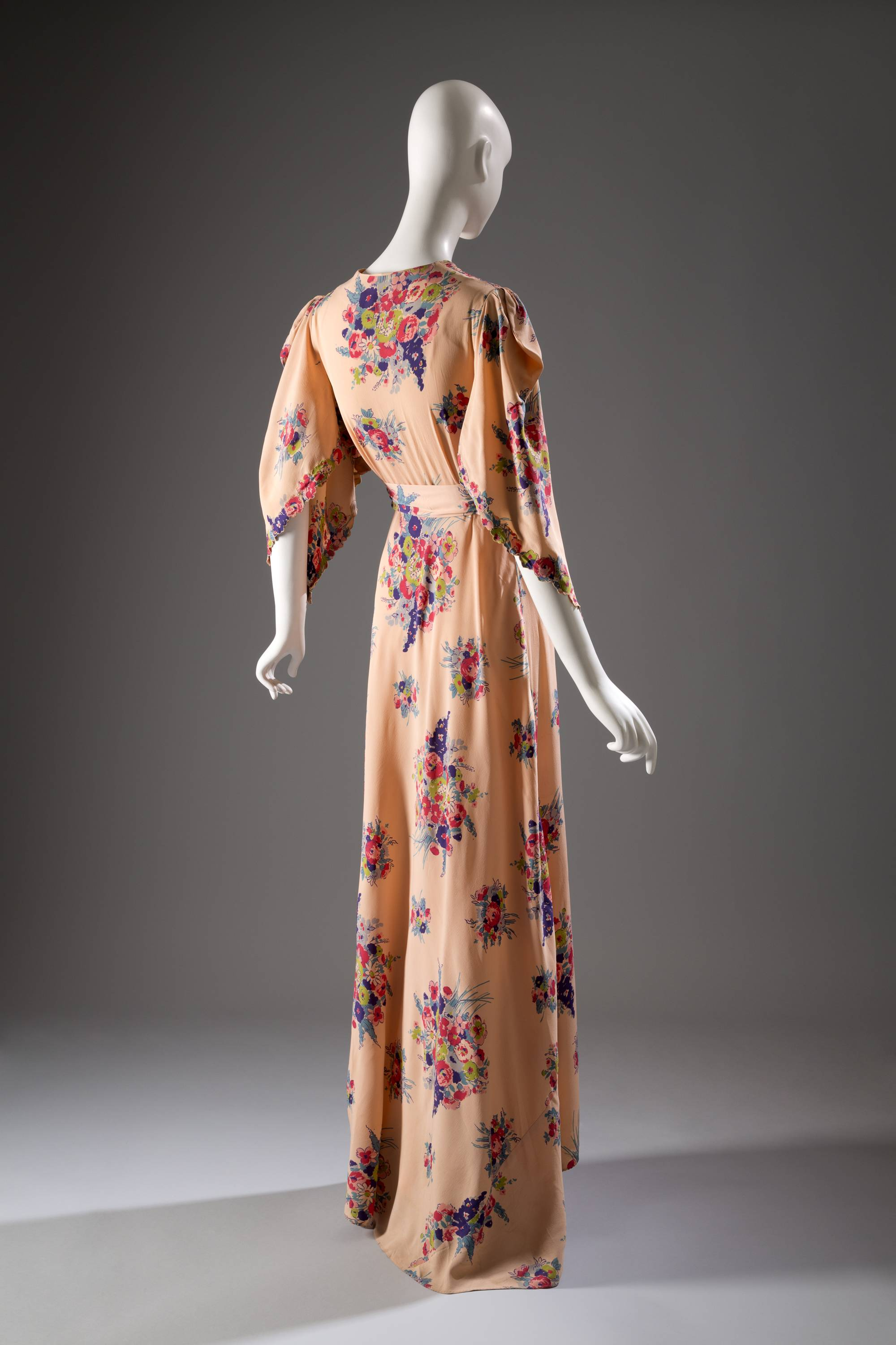 A lounging robe in printed rayon, a U.S. garment, circa 1942, from Jay Thorpe. From a 1770 corset to a 2014 bra-and-panty set in lacy stretch silk, the Museum at the Fashion Institute of Technology has taken on lingerie and ladies foundation garments as the focus of a new exhibition.
