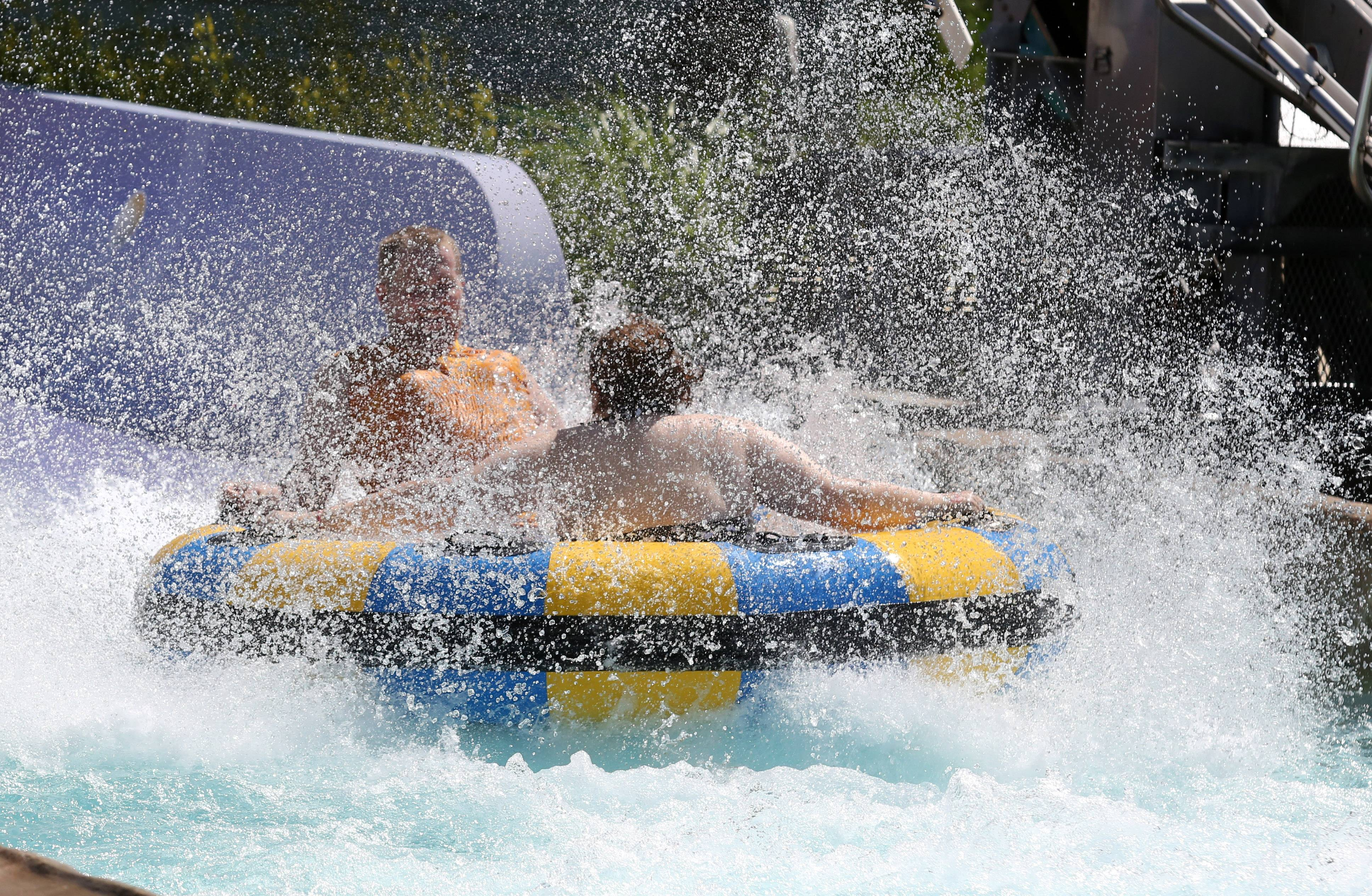 Tyler Herling of Evergreen Park and Dayna Hann of Orland Park splash down at the end of the Bahama Mama extreme rafting ride at Great America's Hurricane Harbor in Gurnee.