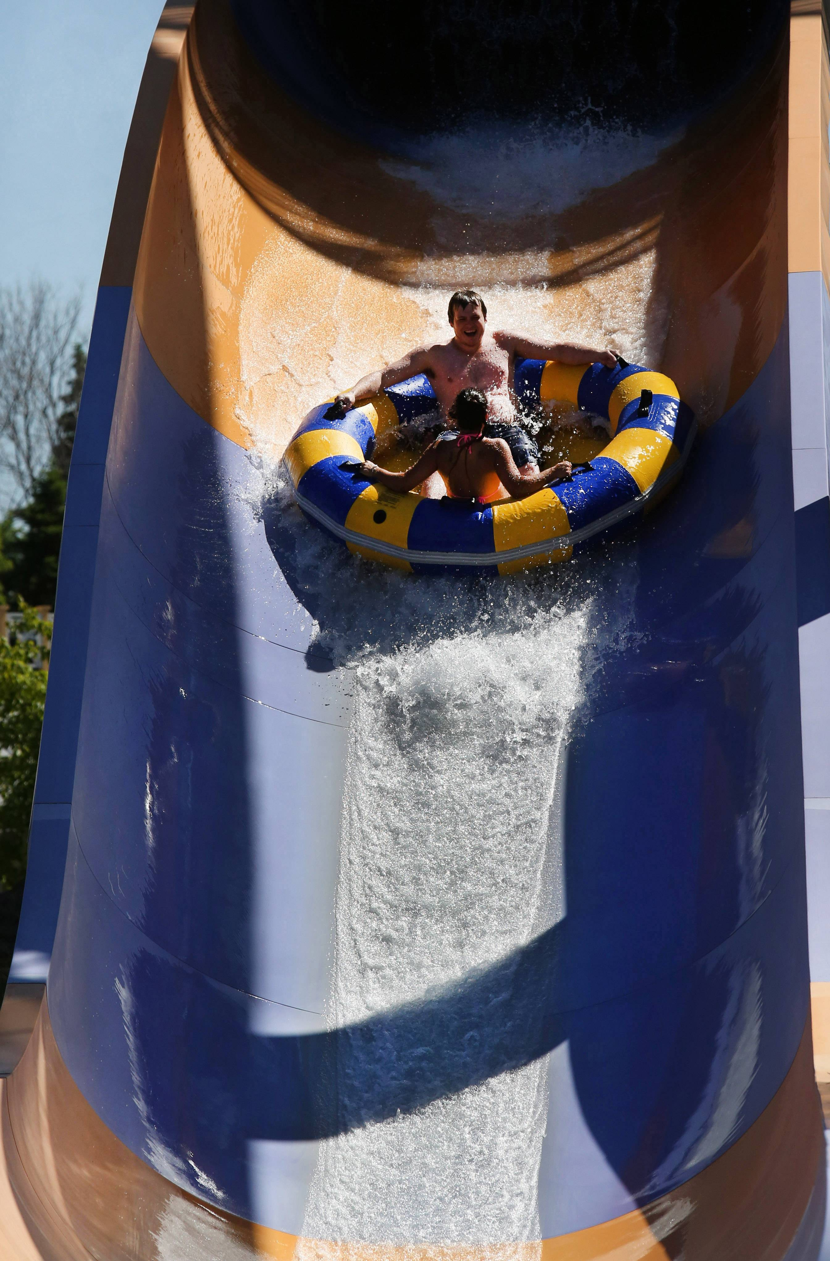 Thrill-seekers experience the final drop of the Bahama Mama extreme rafting ride at Hurricane Harbor.