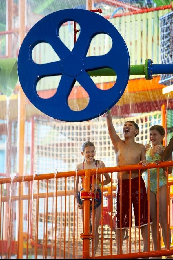 Coco Key water resort's guests splash through the interactive water playground.