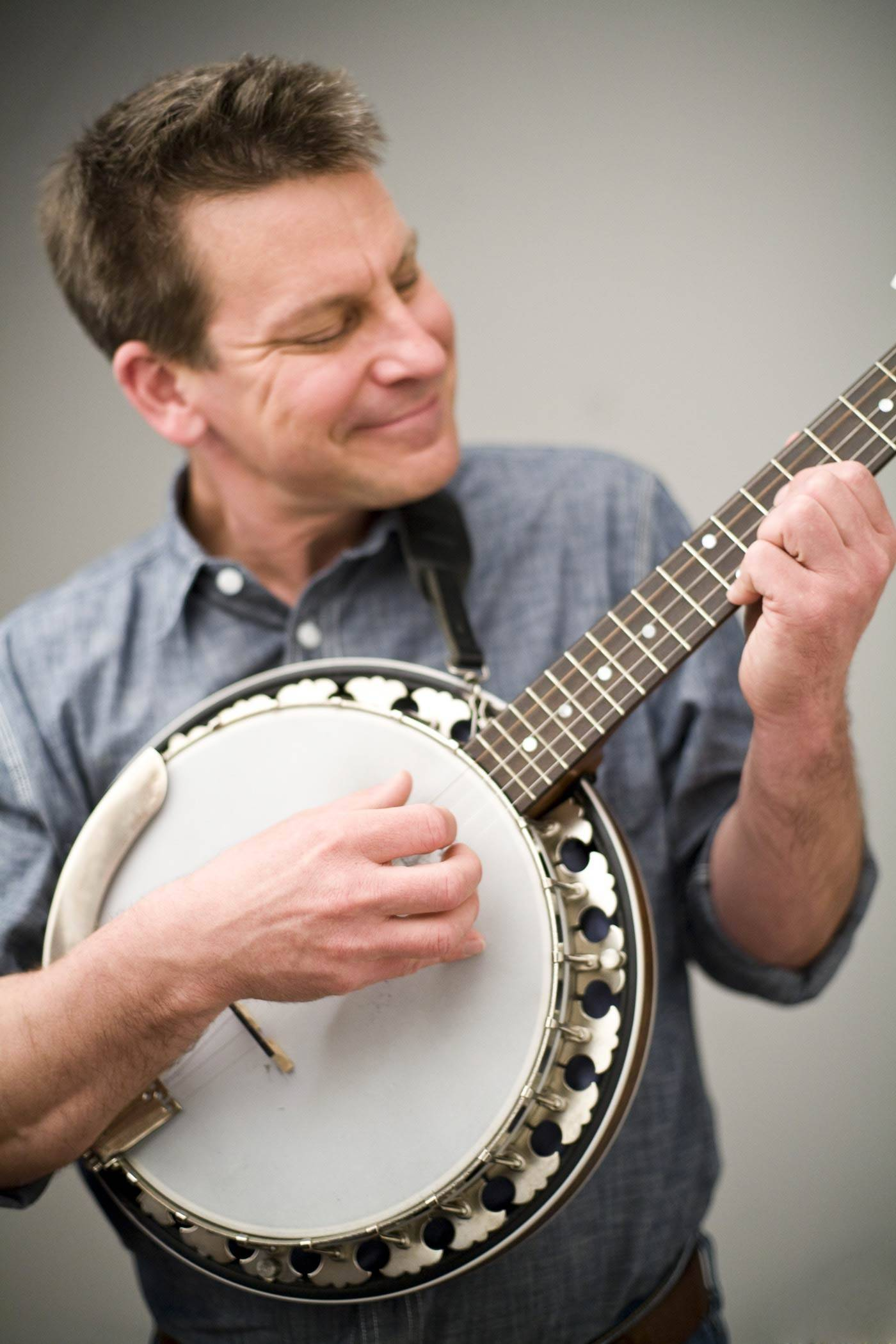 Award-winning musician Jim Gill performs in a family concert in Naperville to benefit the DuPage Children's Museum and the not-for-profit Bridge Communities organization.