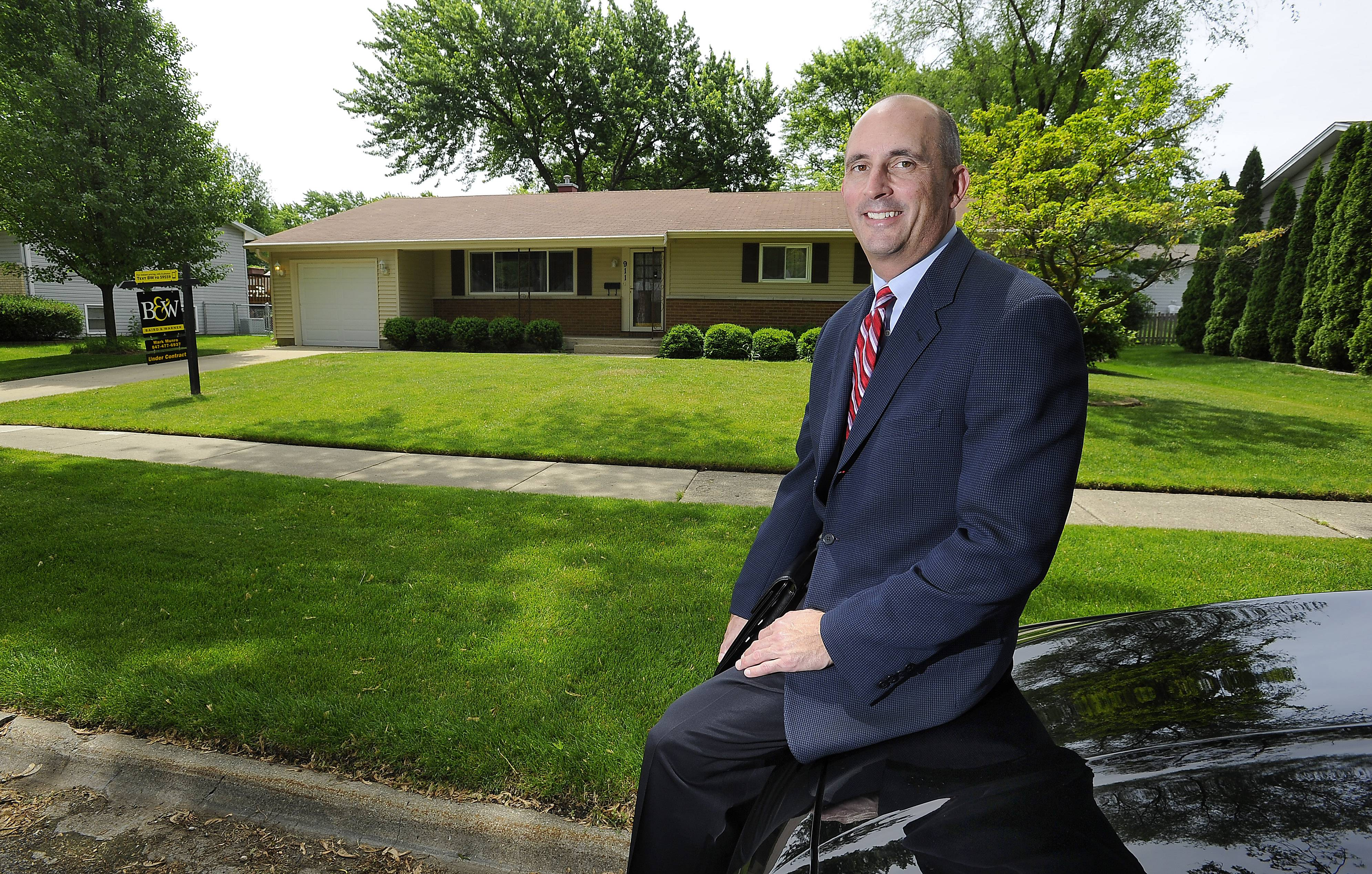 Realtor and broker Mark Munro of Baird & Warner, shown outside a home in Palatine he sold in two days, says the housing market has changed in the past year.