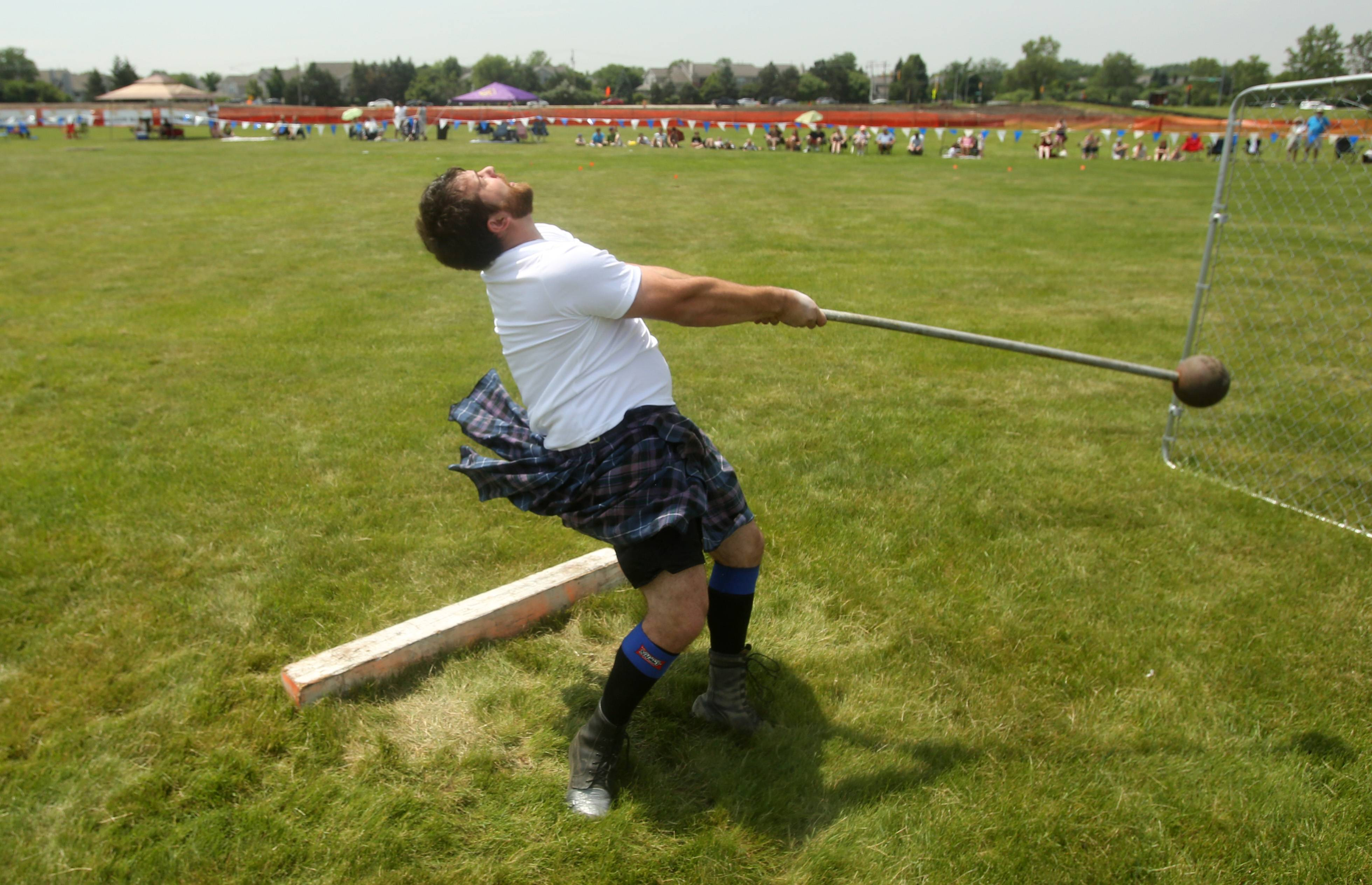Nathan Burchett of Mason City, Iowa, competes in the 22-pound hammer throw during the Scottish Festival and Highland Games at Hamilton Lakes in Itasca.